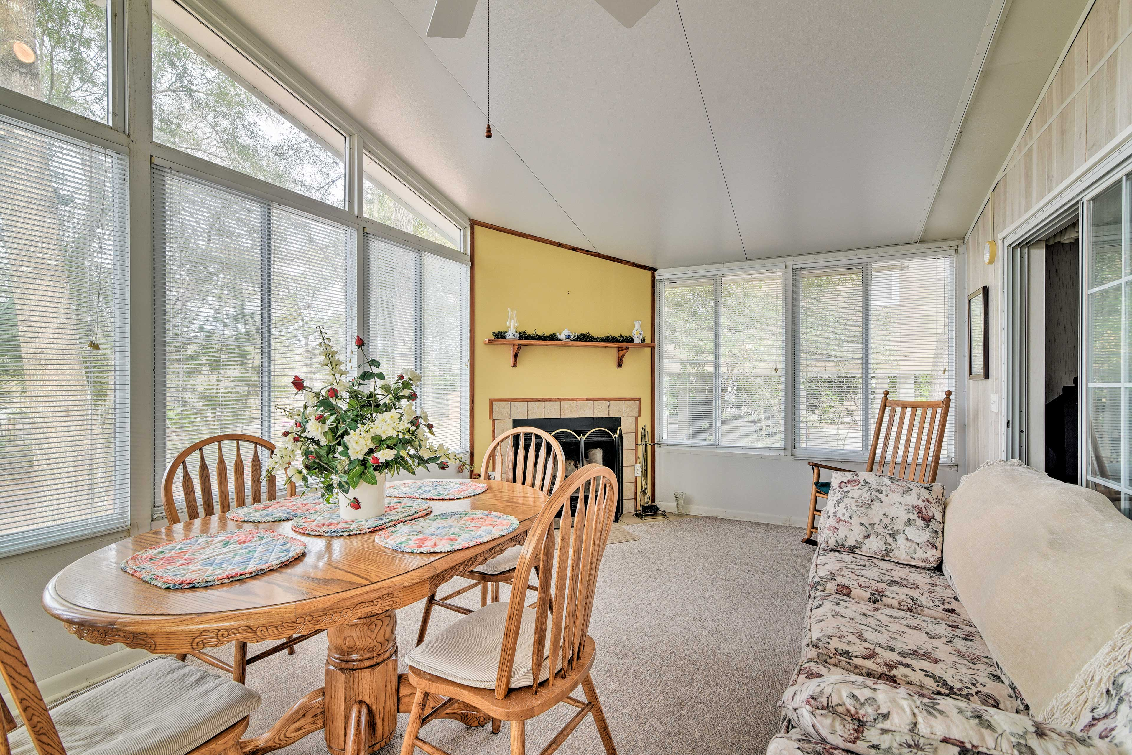 This bright sunroom is ideal for enjoying meals in this quaint home!
