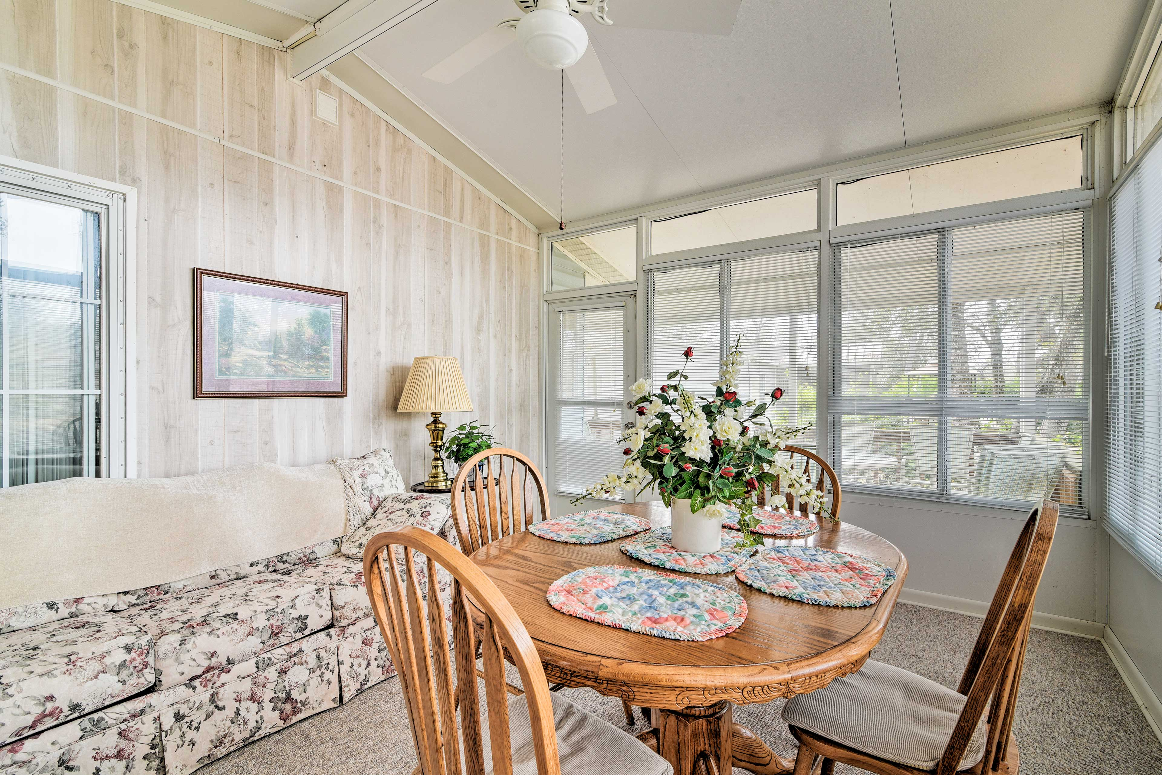 A bright and cheery sun room will have you feeling right at home.