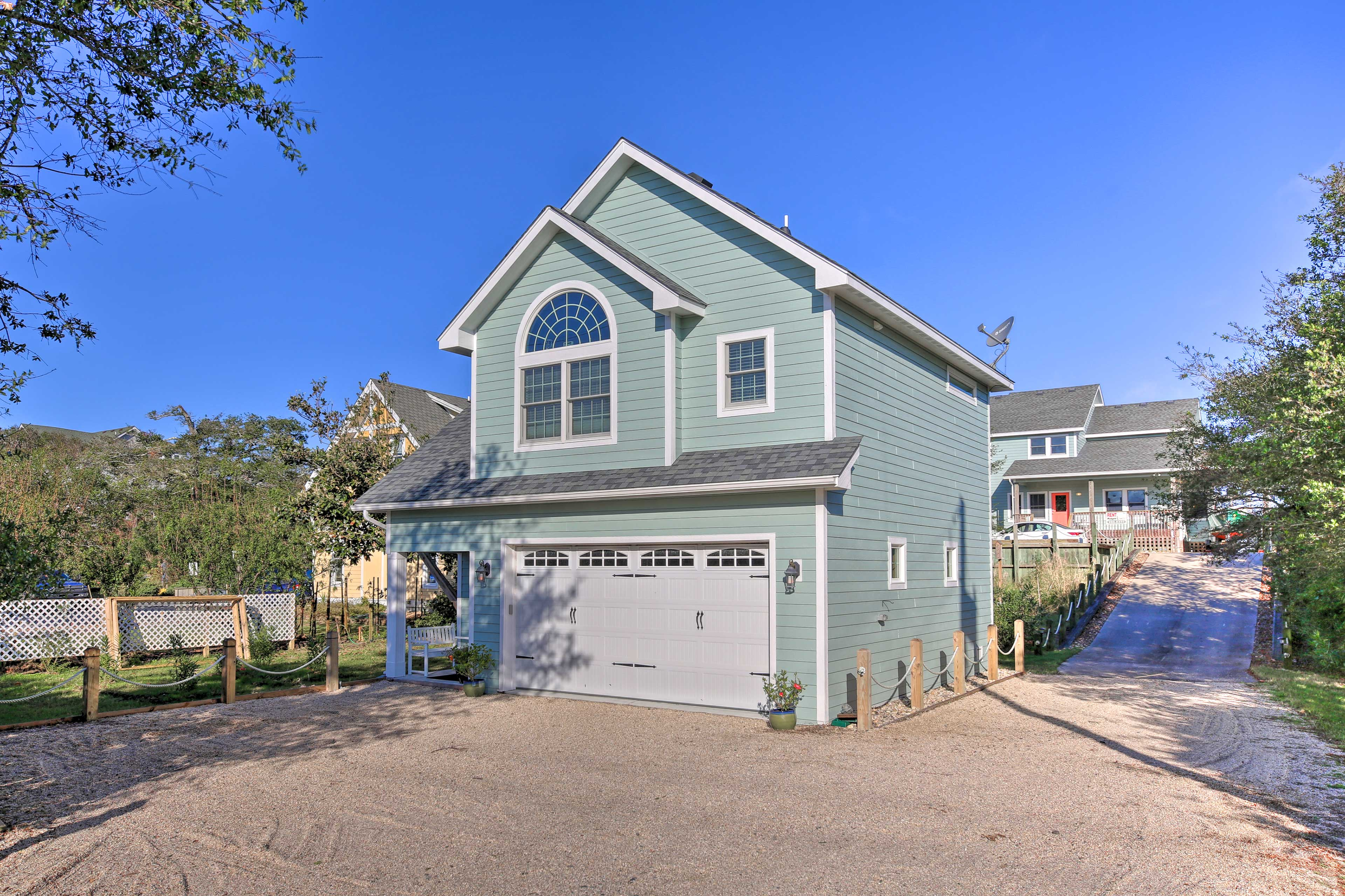 Call this bright blue cottage home for a spontaneous coastal getaway!