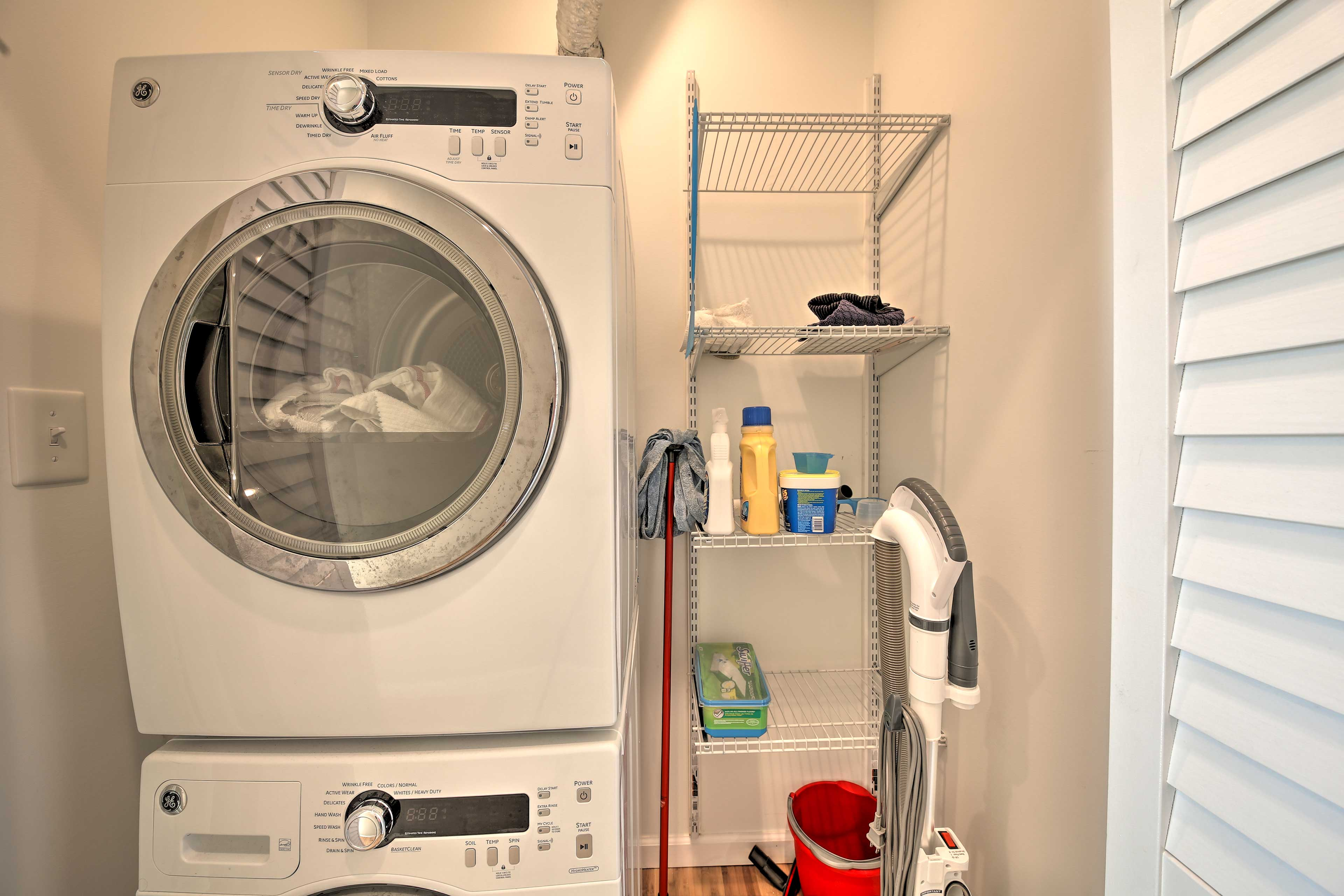 Keep your clothes fresh and clean with the home's stacked laundry machines.