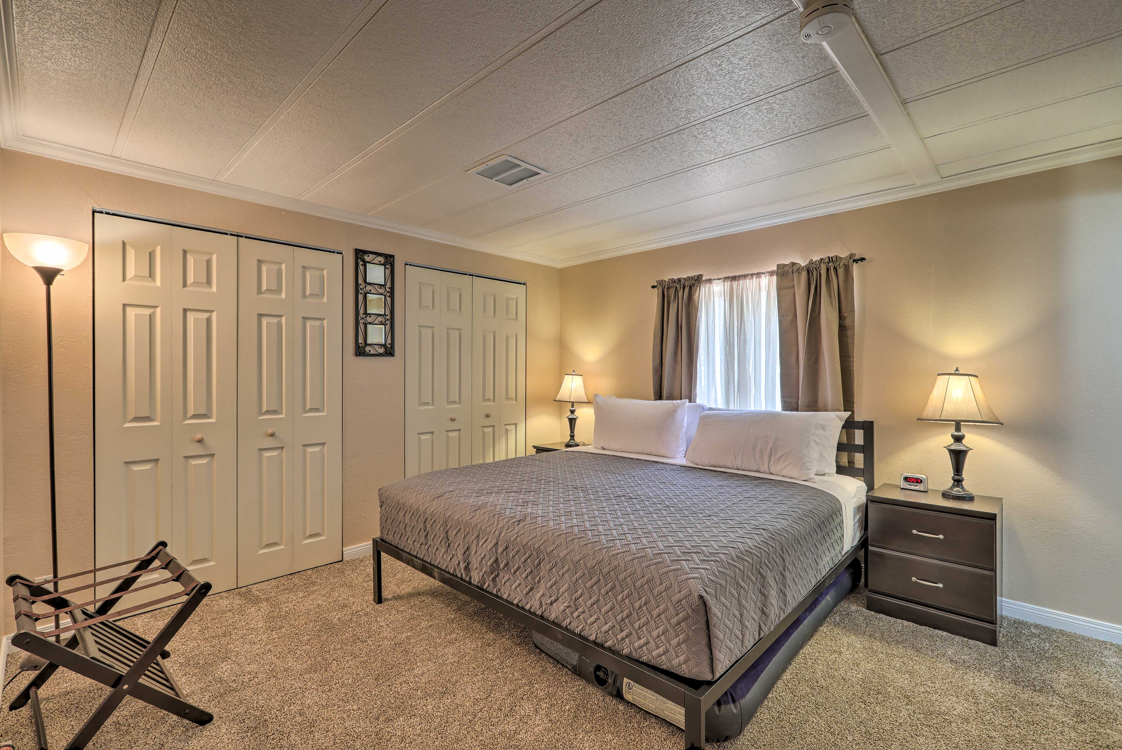 The master bedroom is complete with a king bed and full-sized air mattress.