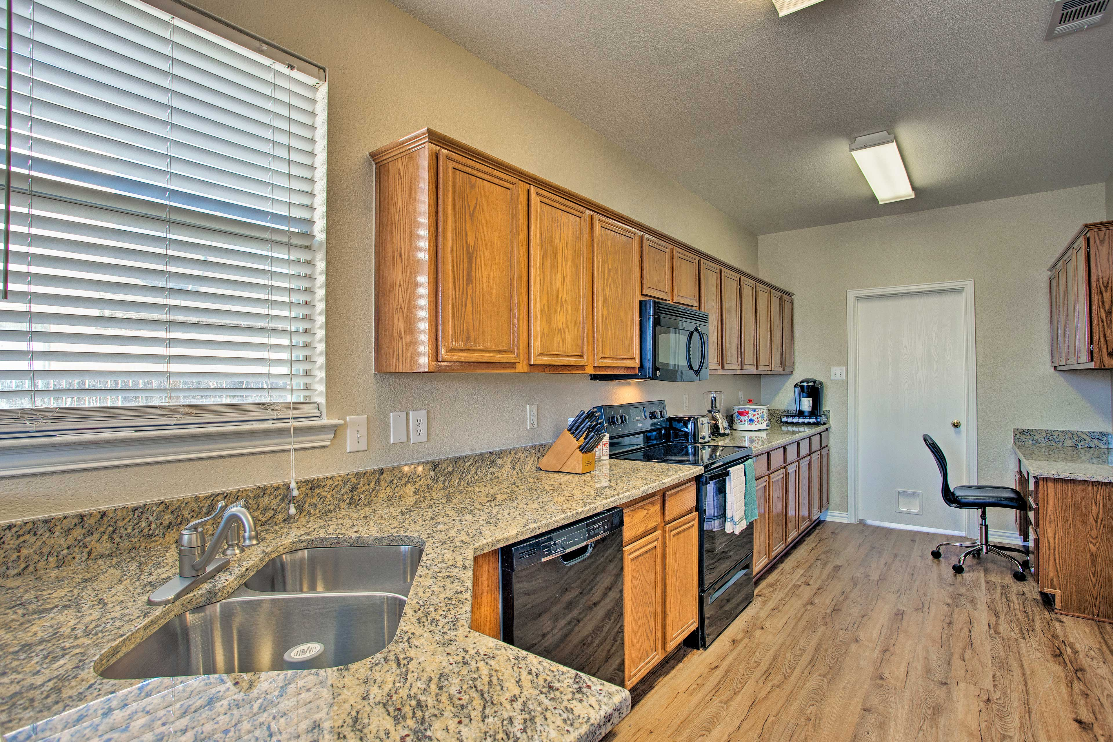 Prepare meals together in this spacious kitchen.