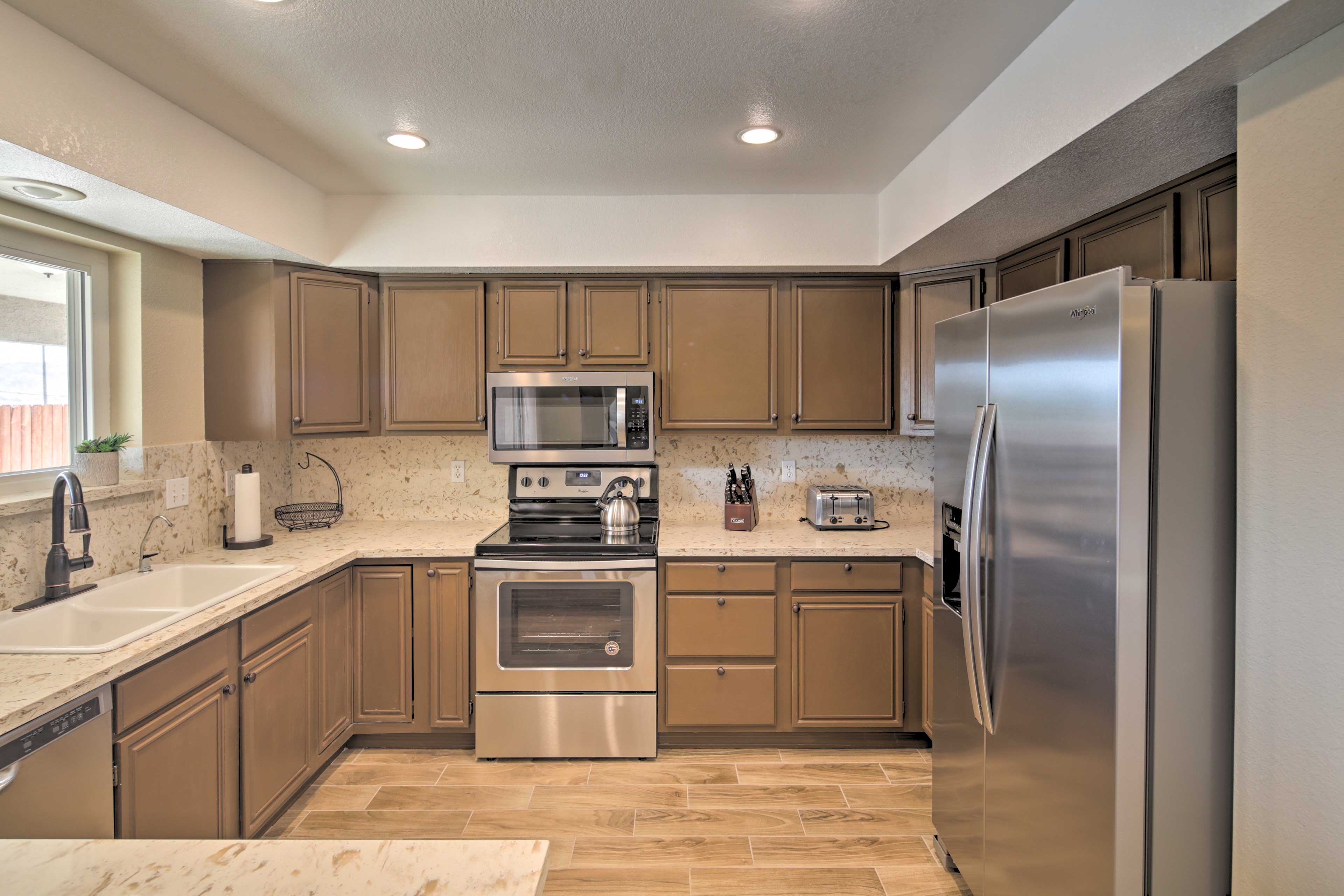 Stainless steel appliances furnish the wraparound counters.