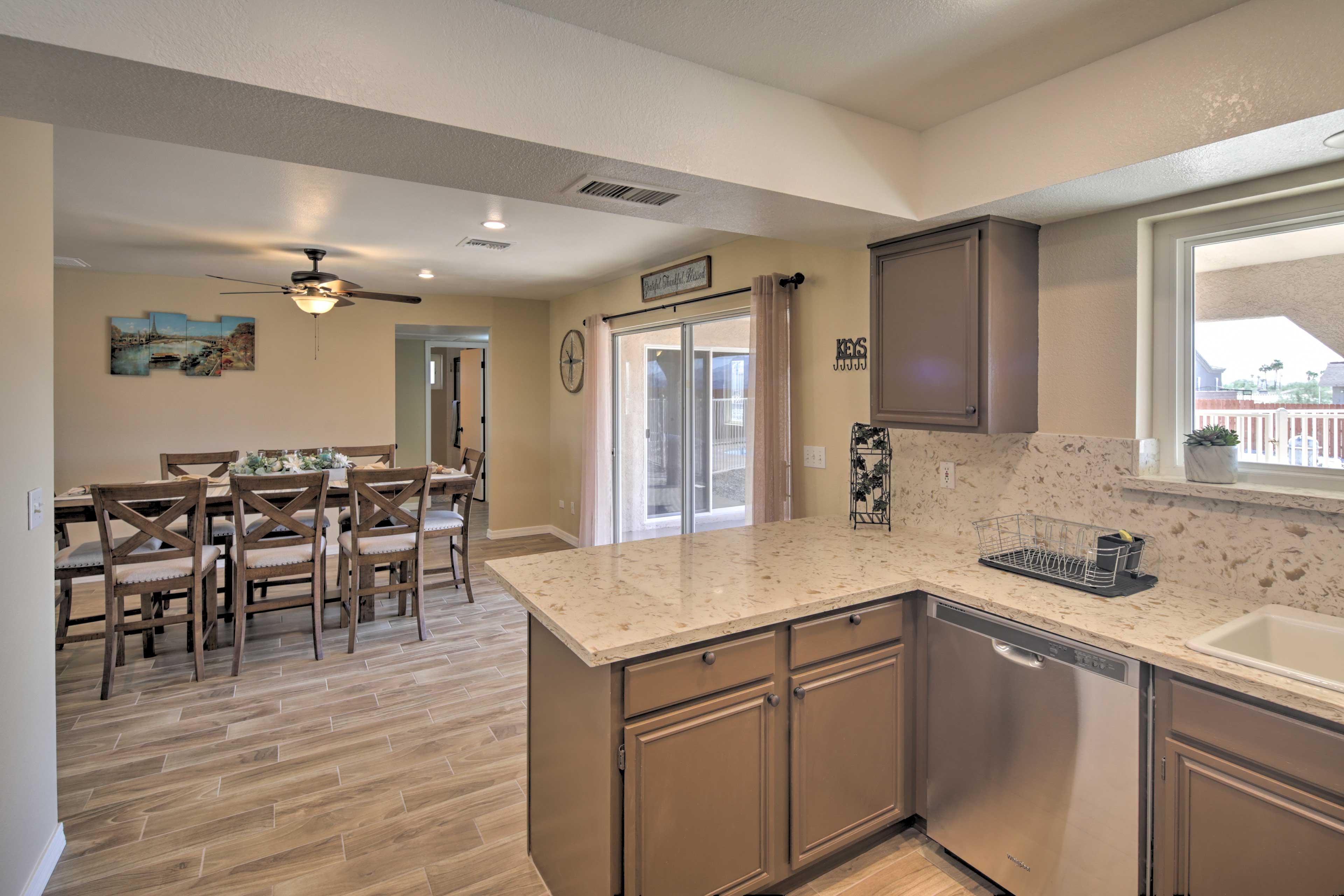 The kitchen is fully equipped, featuring sleek counters.