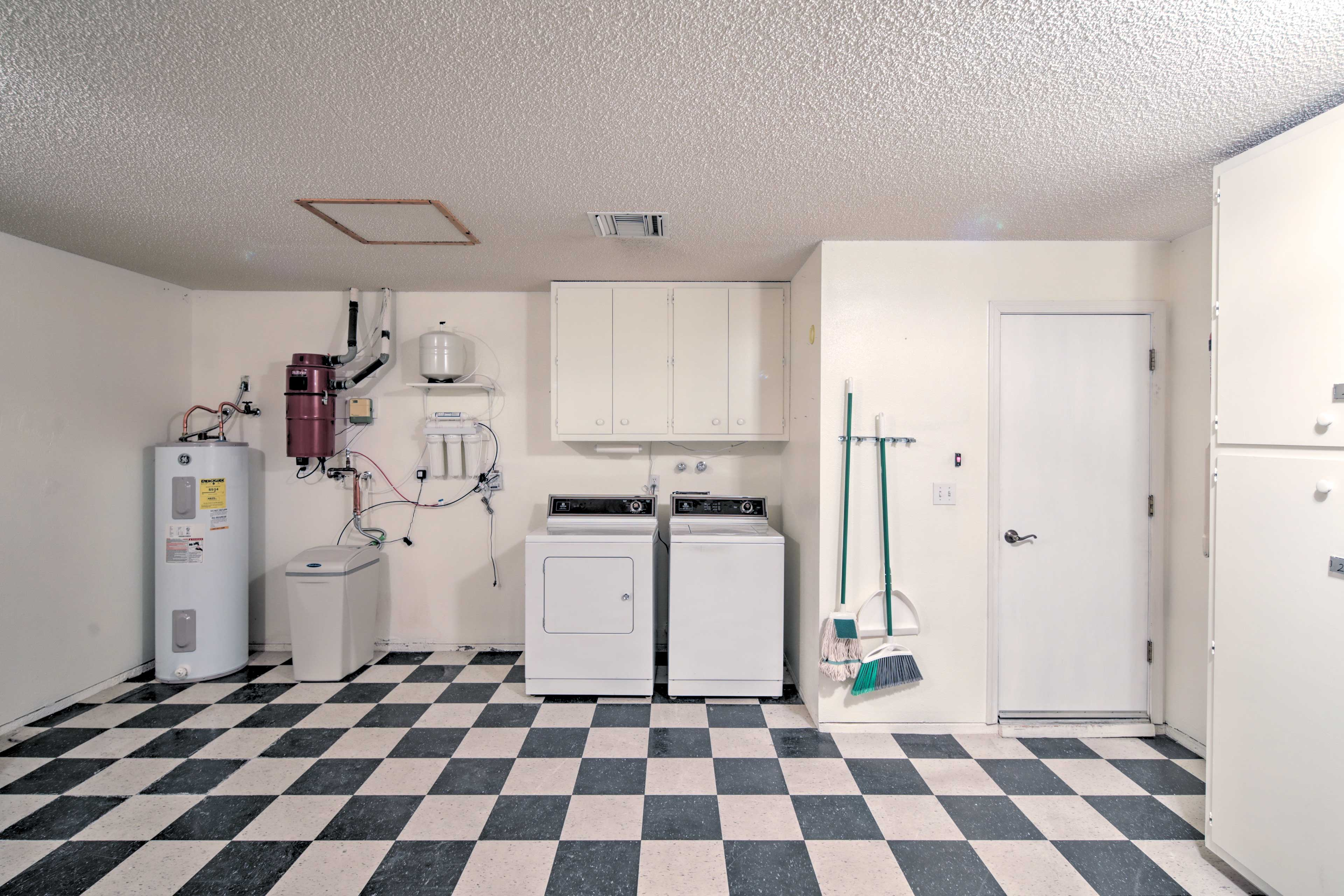 The garage boasts a washer and dryer for your convenience.
