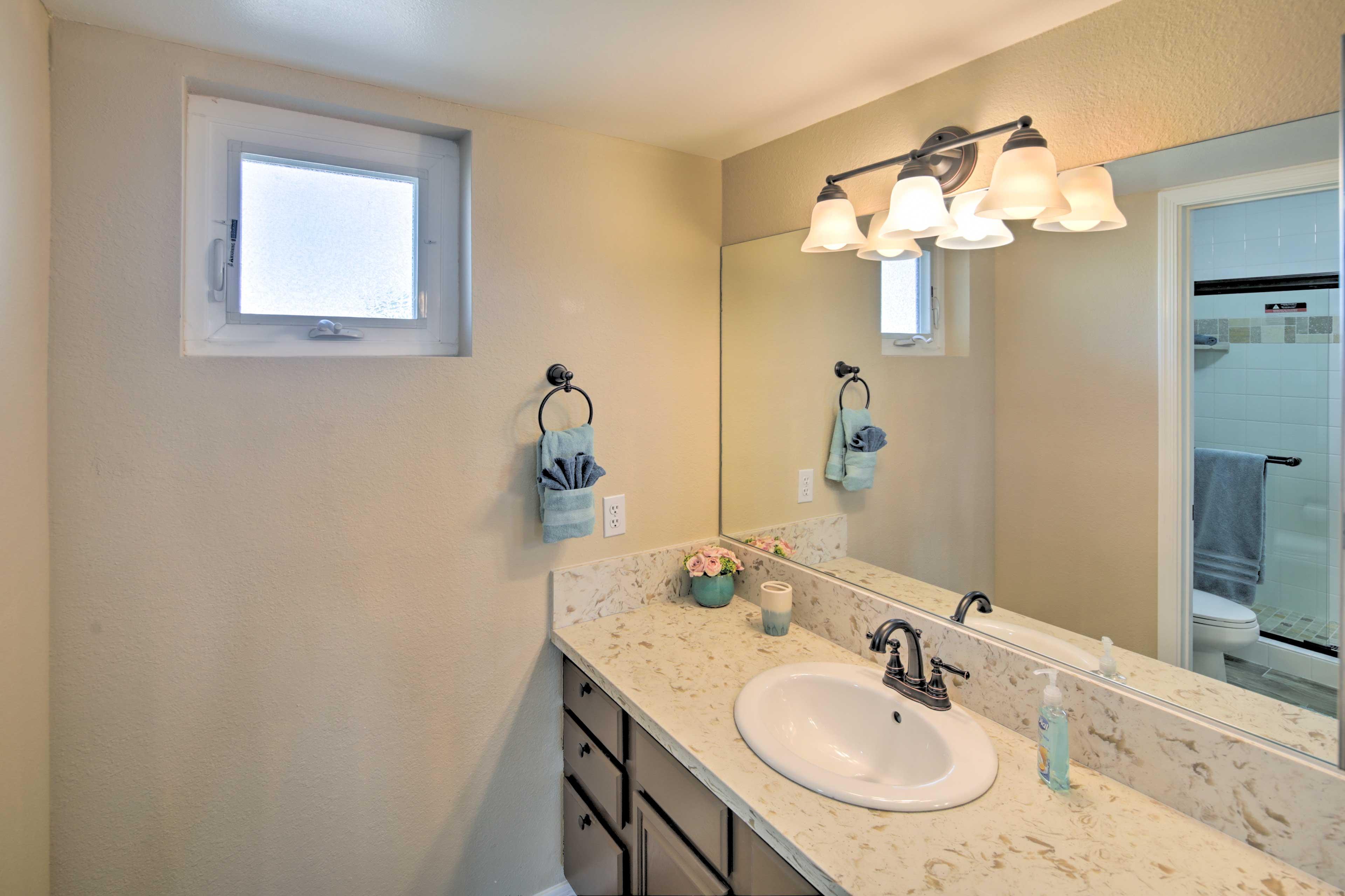 The en-suite bath features a walk-in glass-enclosed shower!