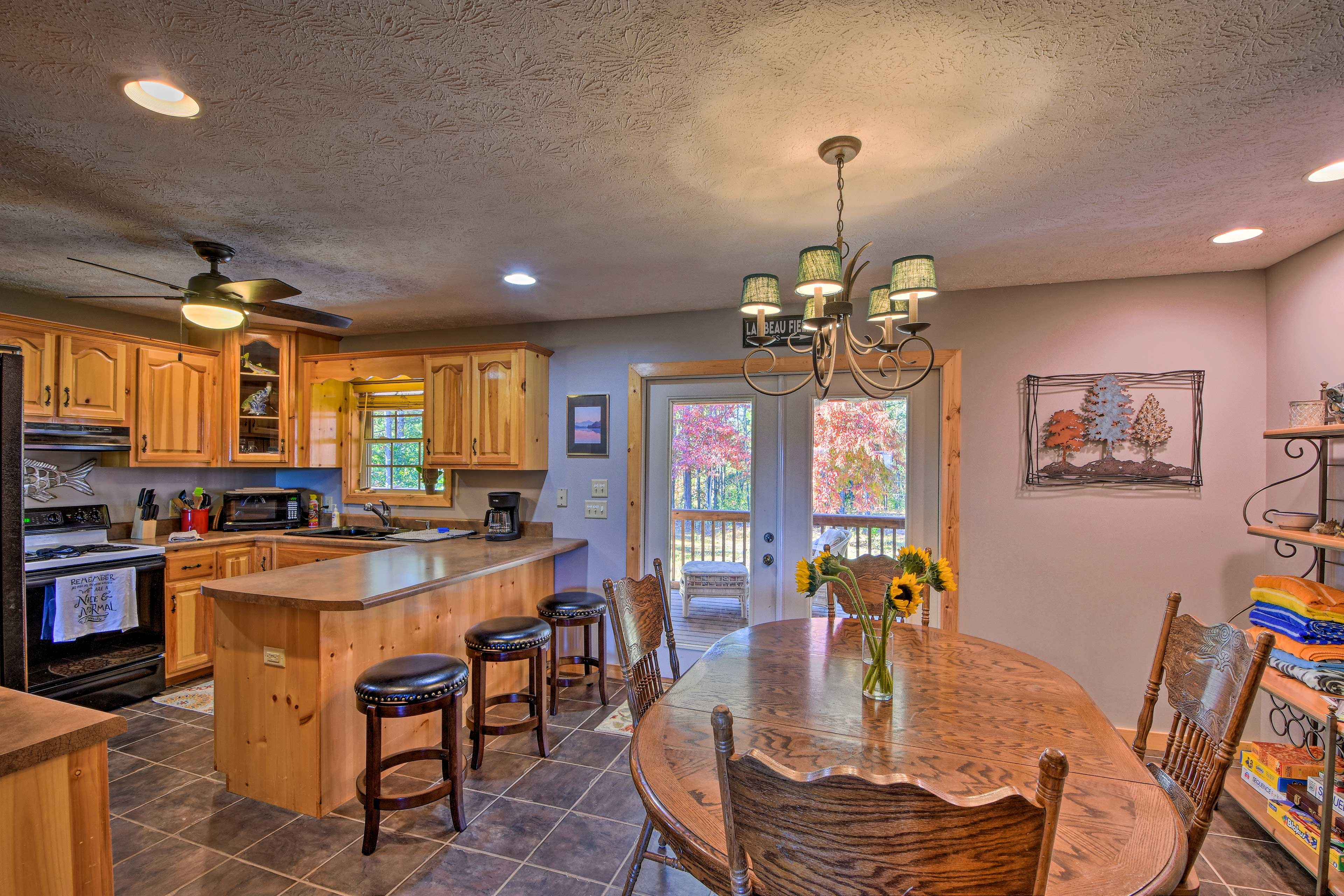 The kitchen features an open space for entertainment.