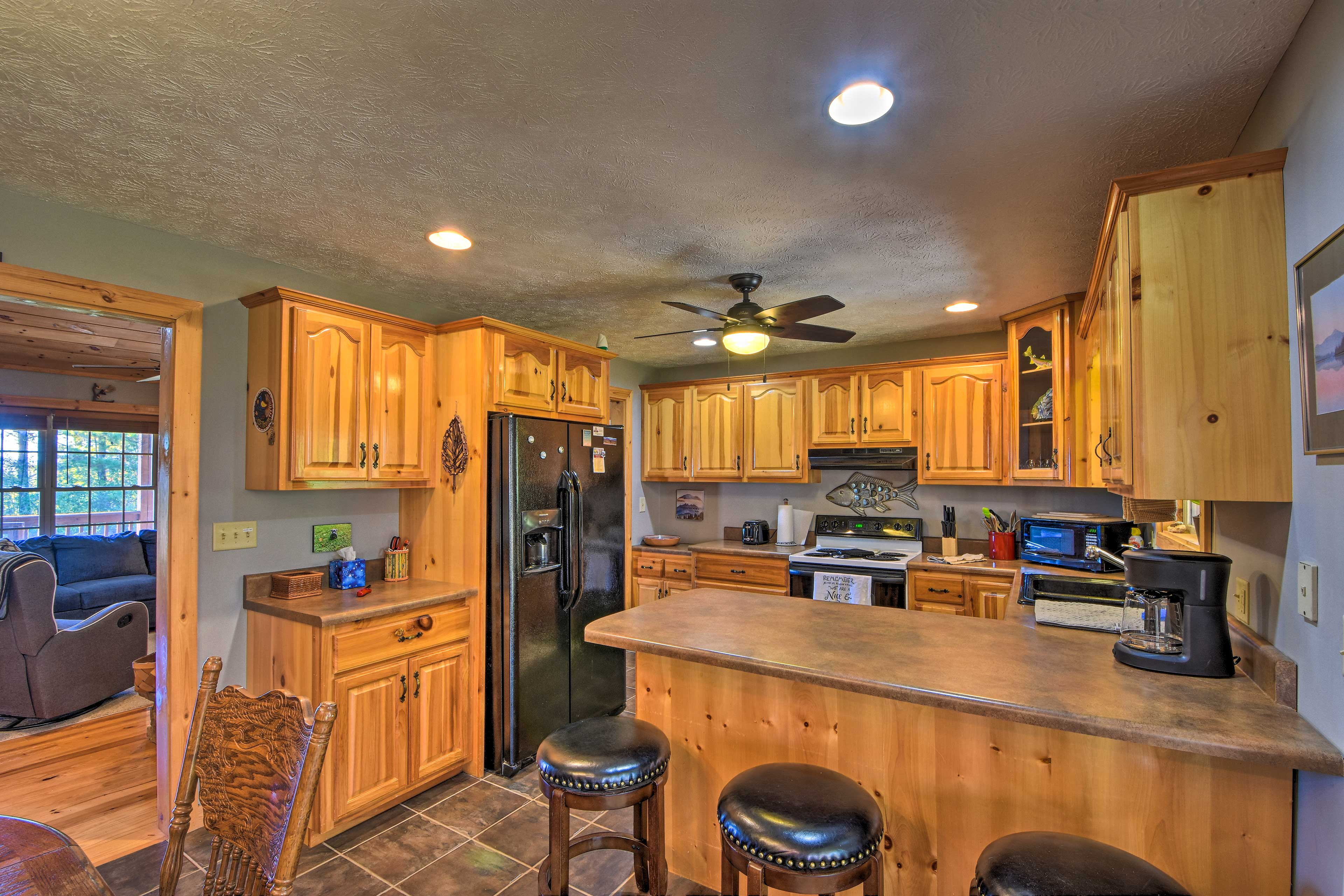 The fully equipped kitchen features all essential cookware.