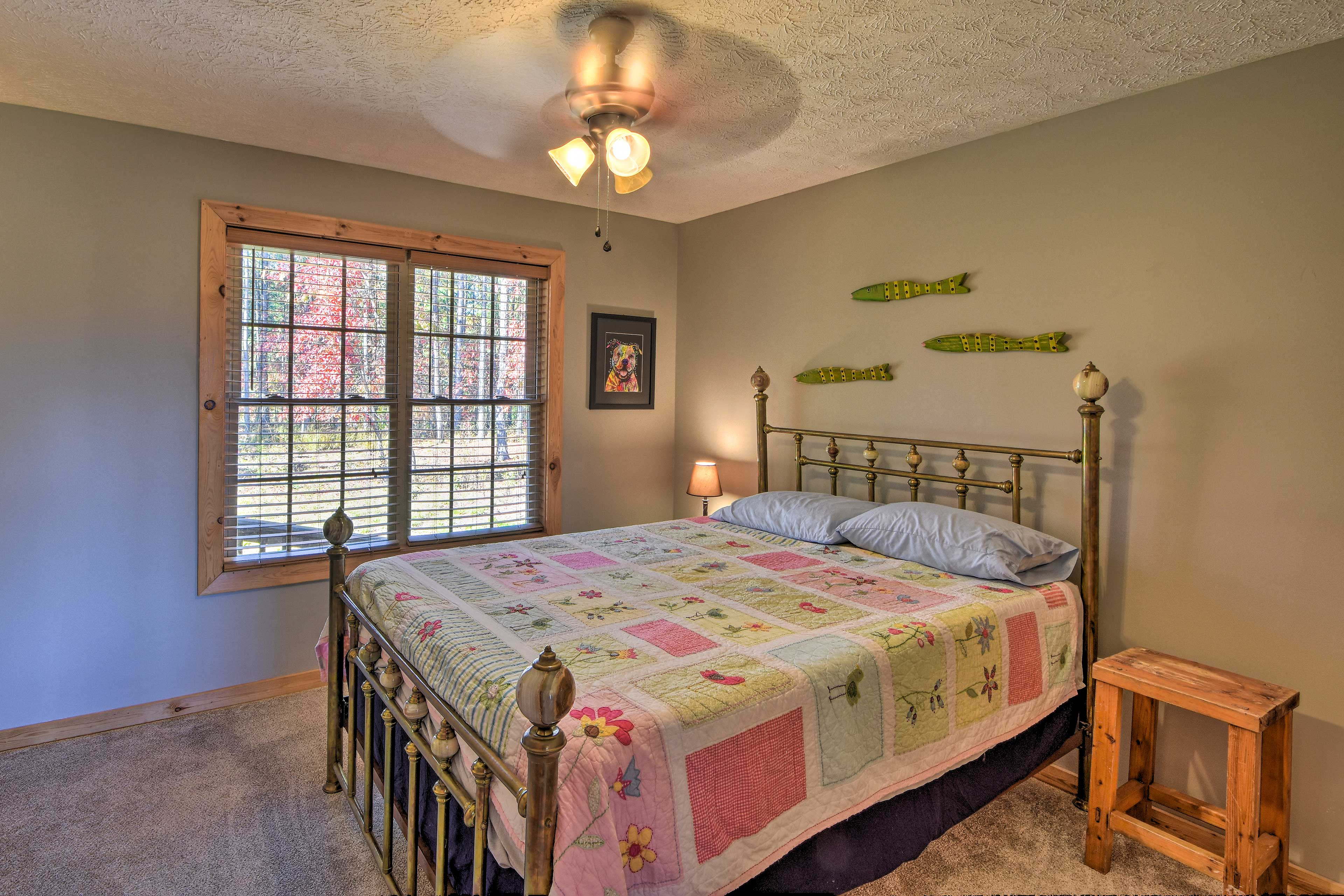 The second bedroom features a queen bed.