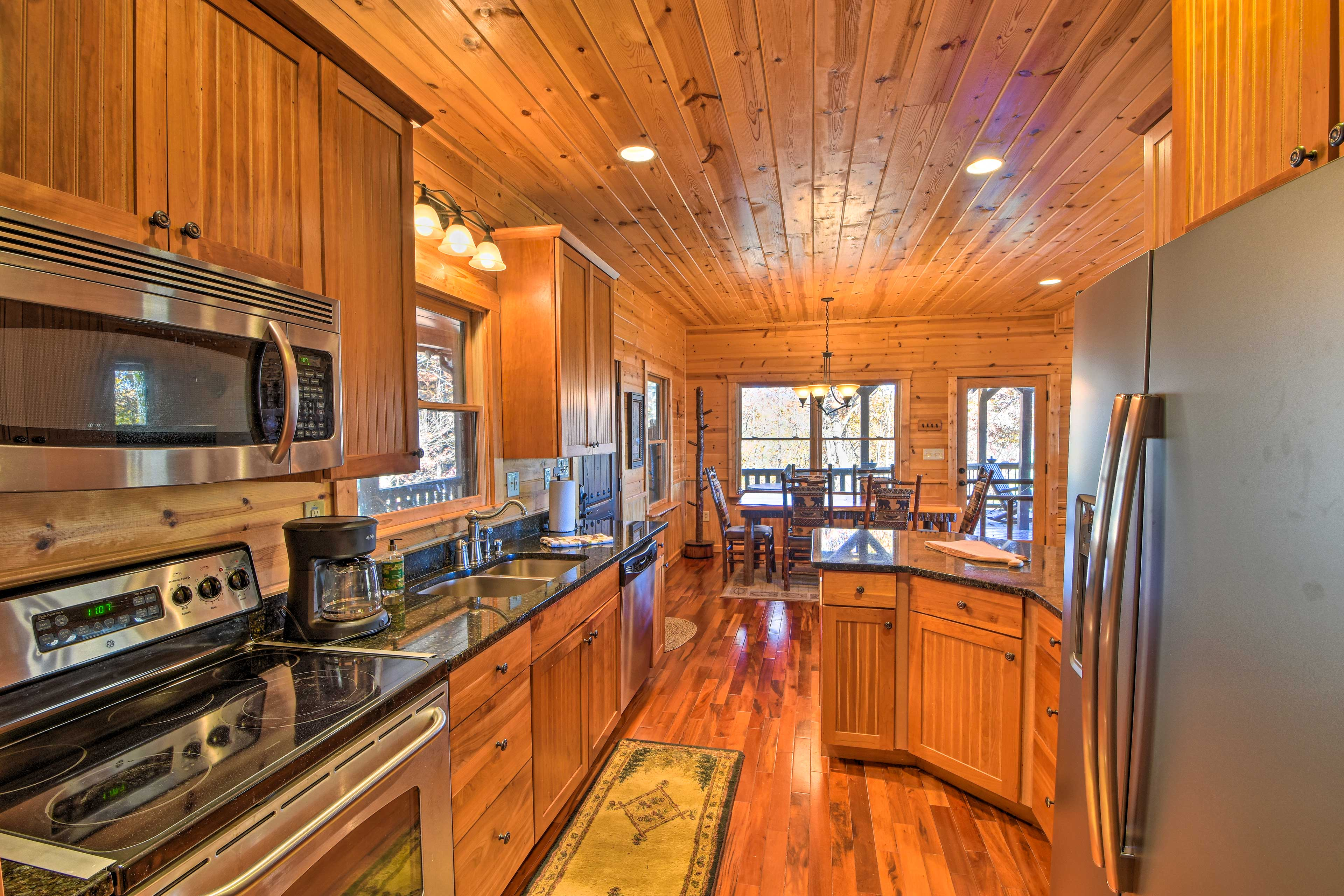 Enjoy whipping up your favorite recipes in this kitchen.