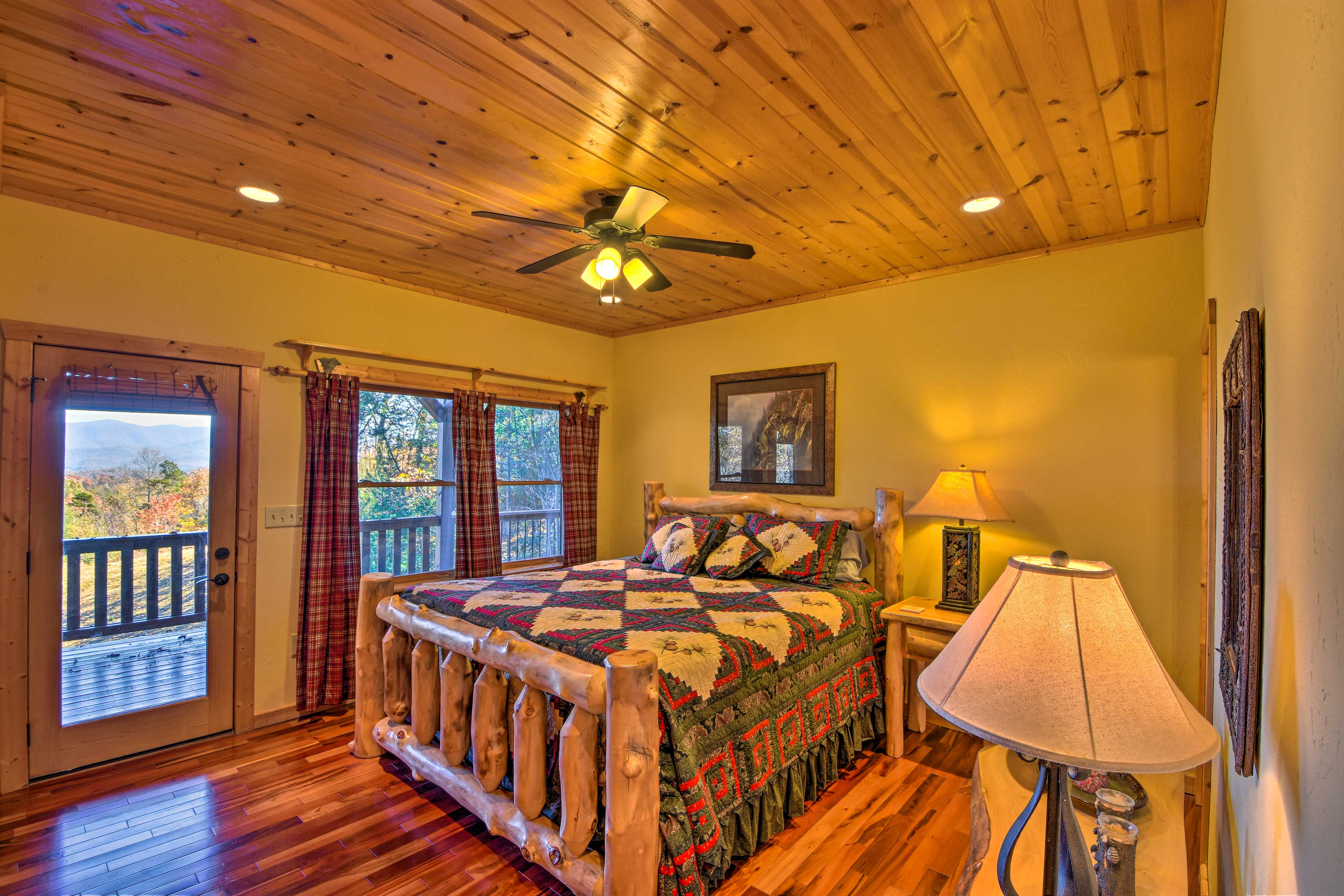 The second bedroom is also equipped with a king-sized bed and a flat-screen TV.