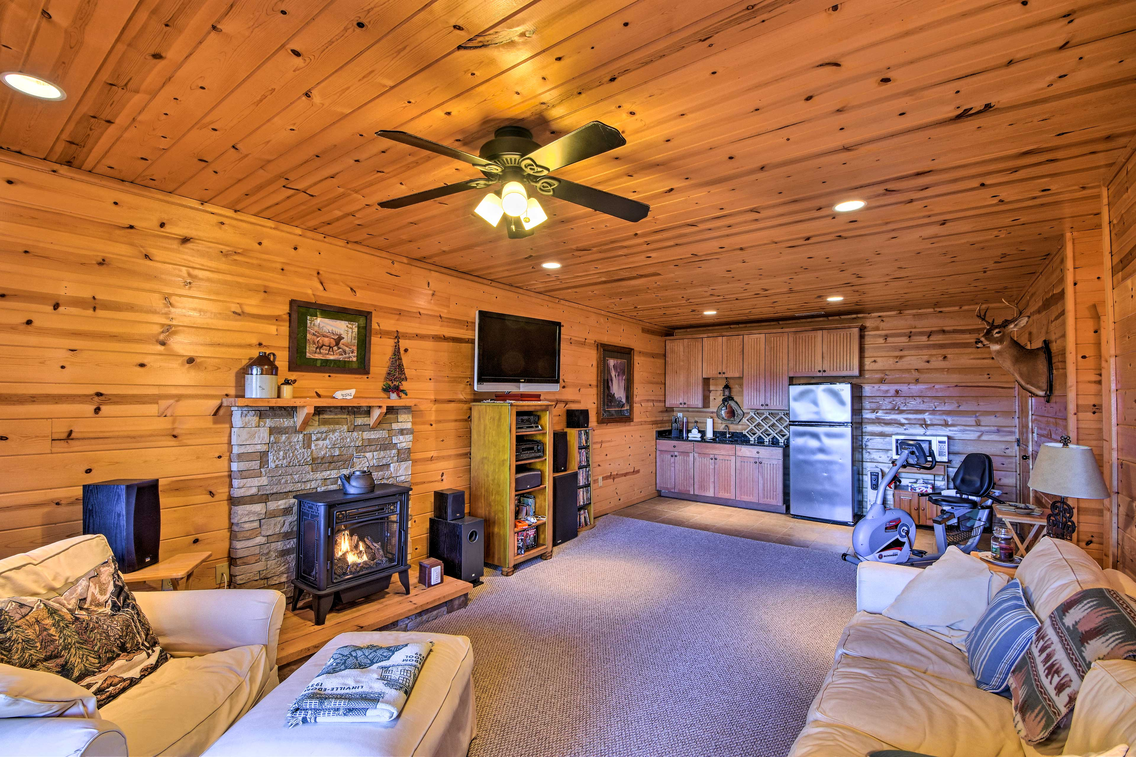 The lower-level features a wet bar, fireplace, and flat-screen TV.