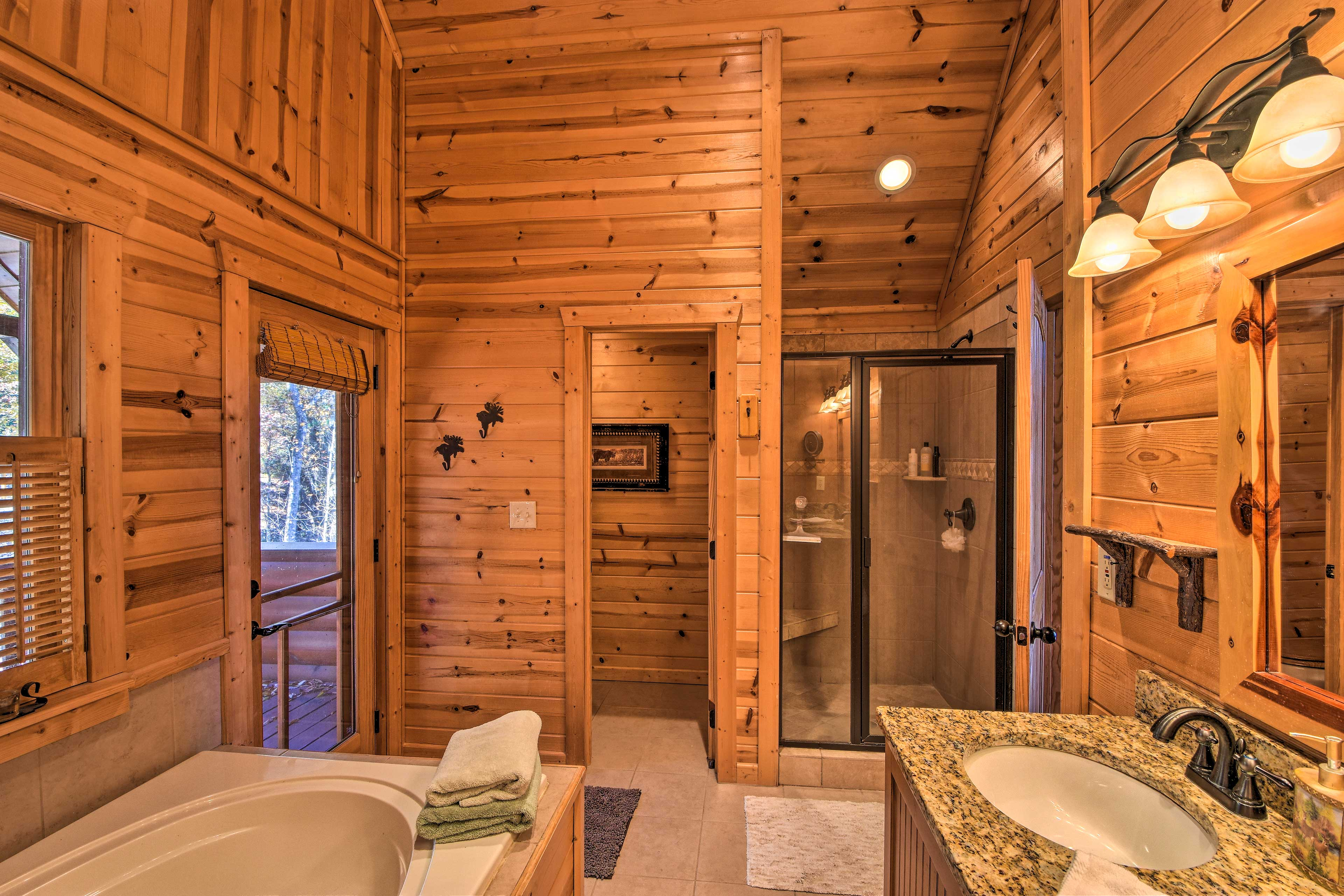 The master en-suite features a walk-in shower and jetted tub.