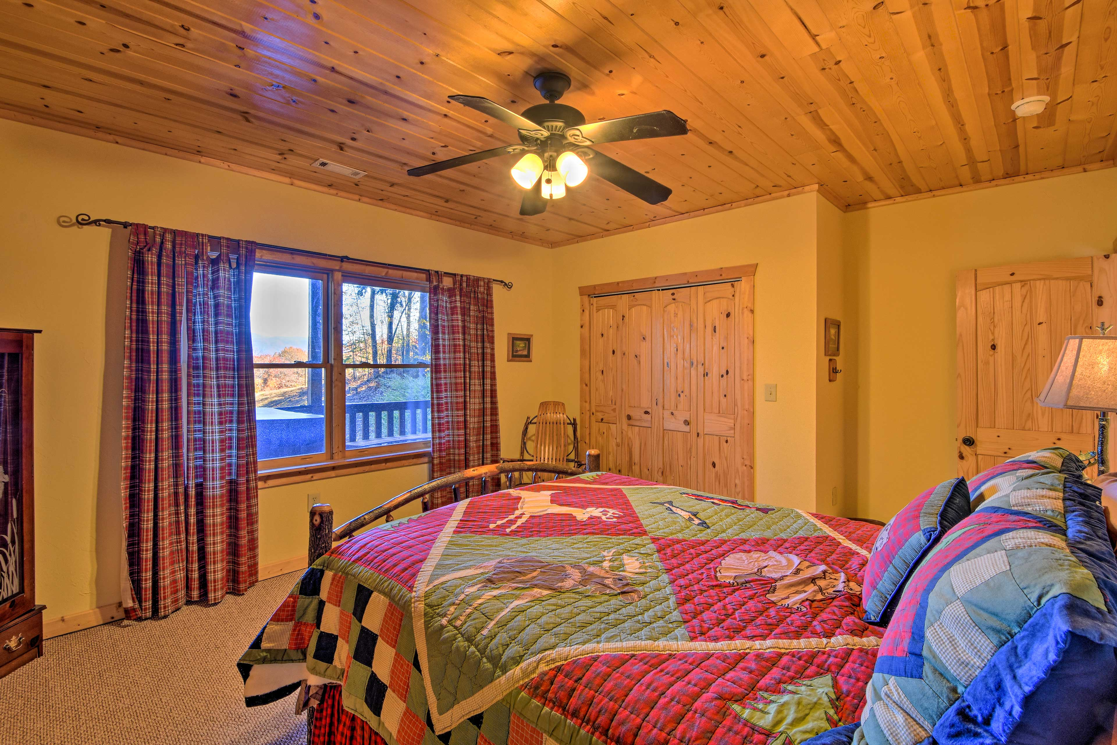 Two travelers will sleep comfortably under the ceiling fan in this room.