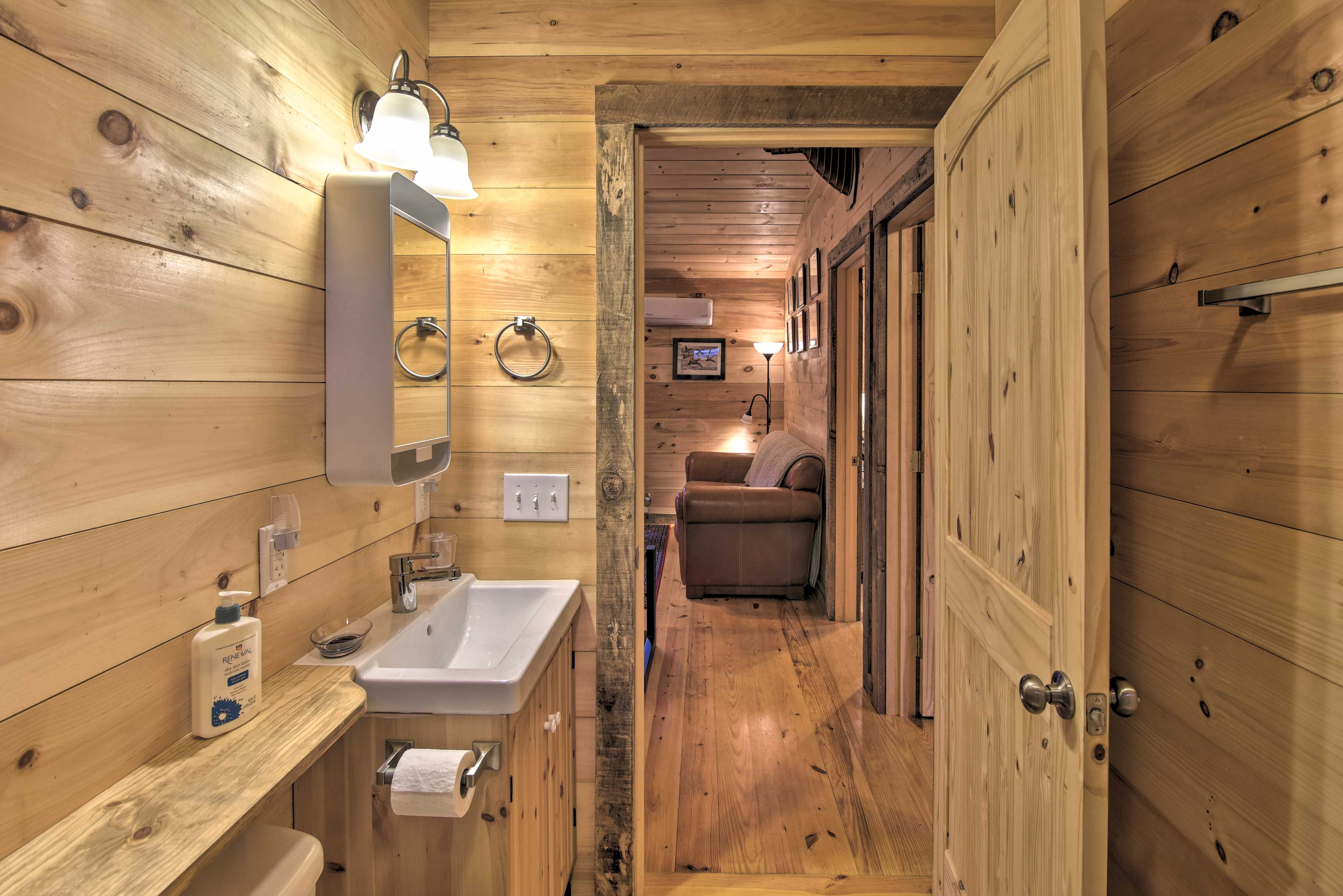 The bathroom is located off the living room.
