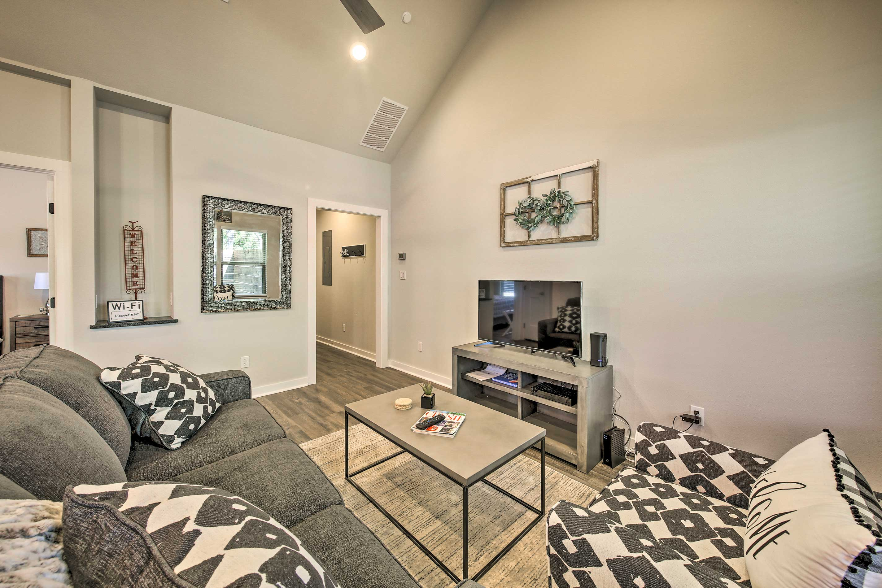 The space includes a flat-screen cable TV, couch and matching armchair.