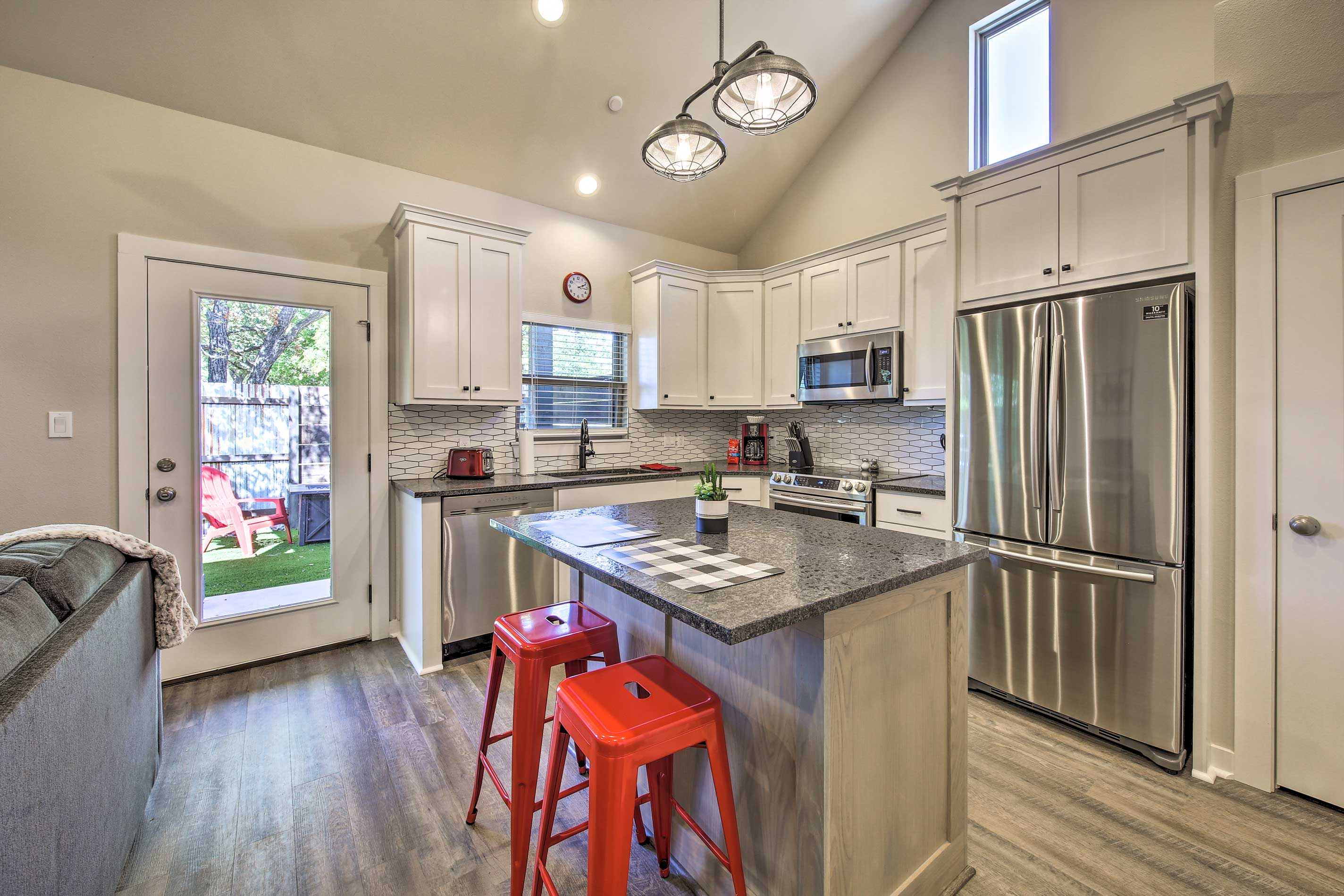 The kitchen comes complete with stainless steel appliances and a center island.