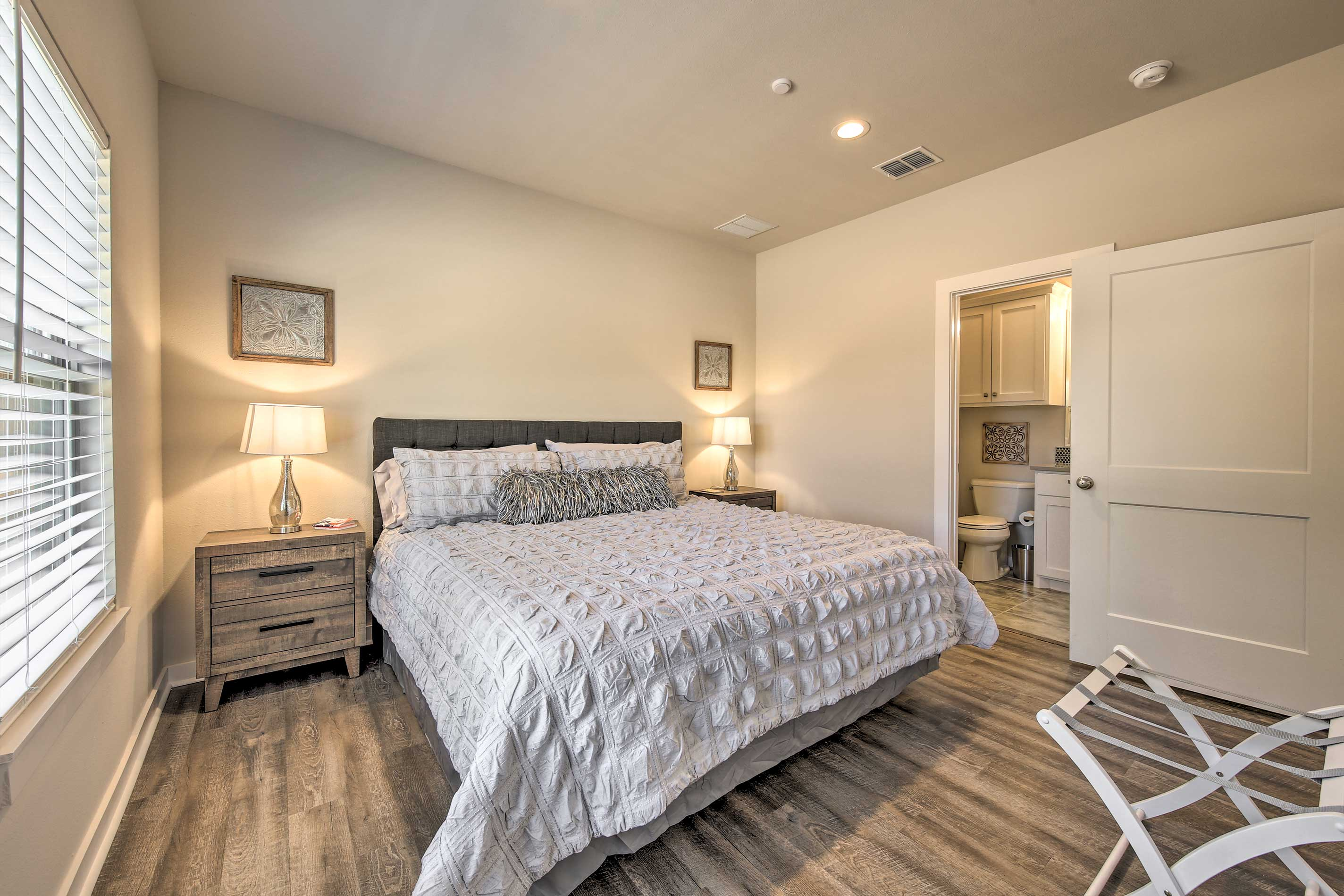 The bedroom houses a king-sized bed and ample closet storage.