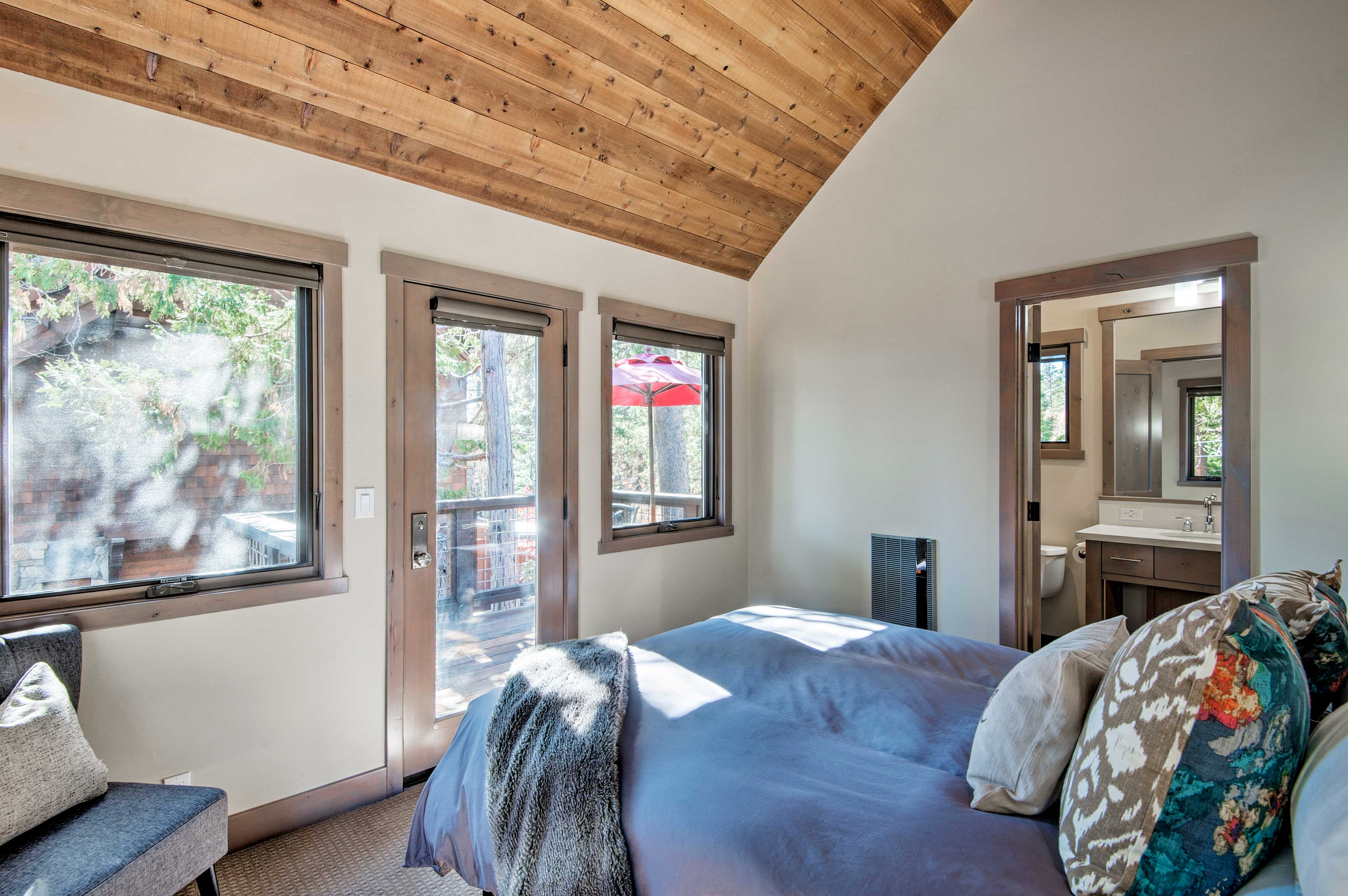 The second-story master bedroom overlooks the scenic property.