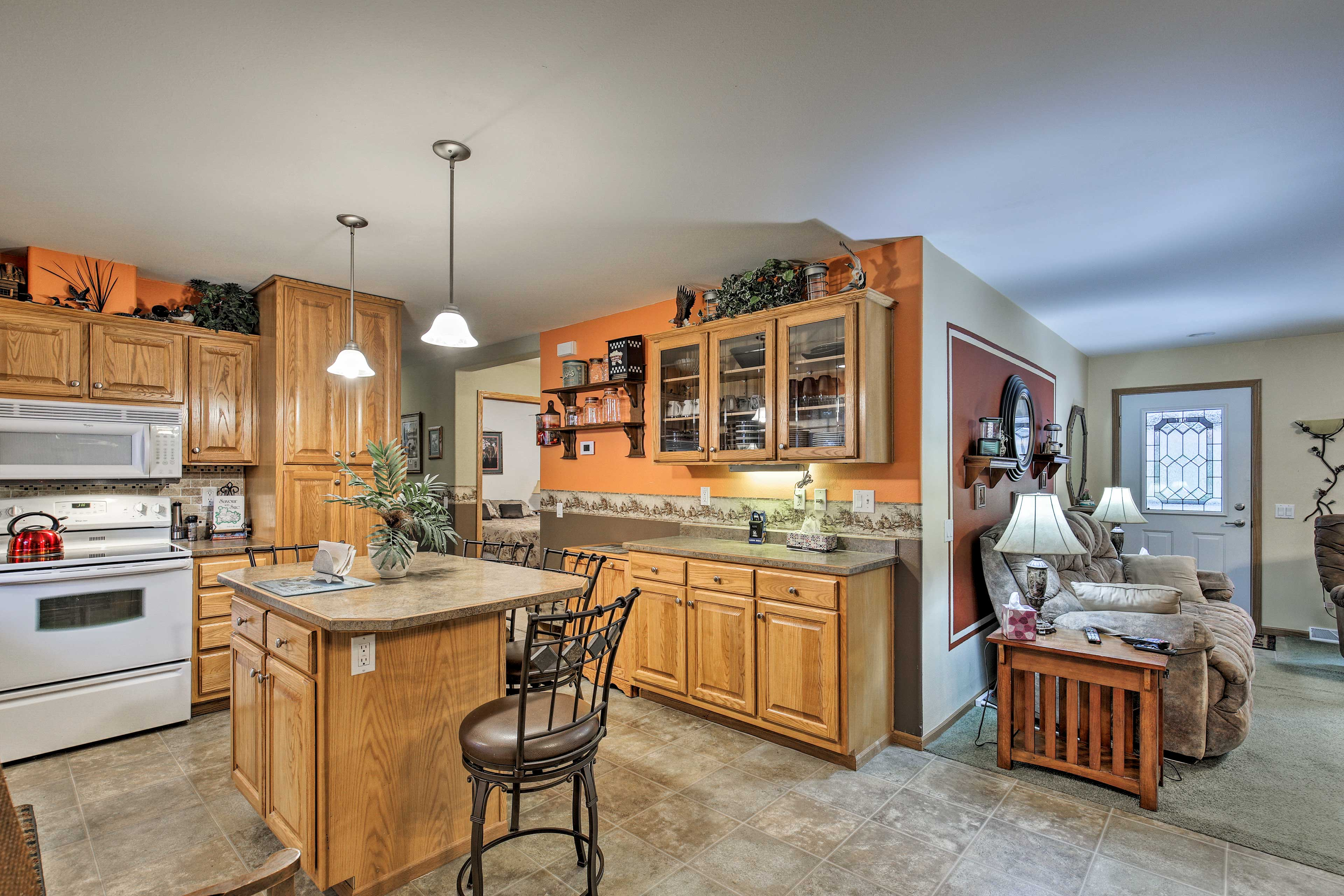 The open floor plan connects the living and kitchen areas.