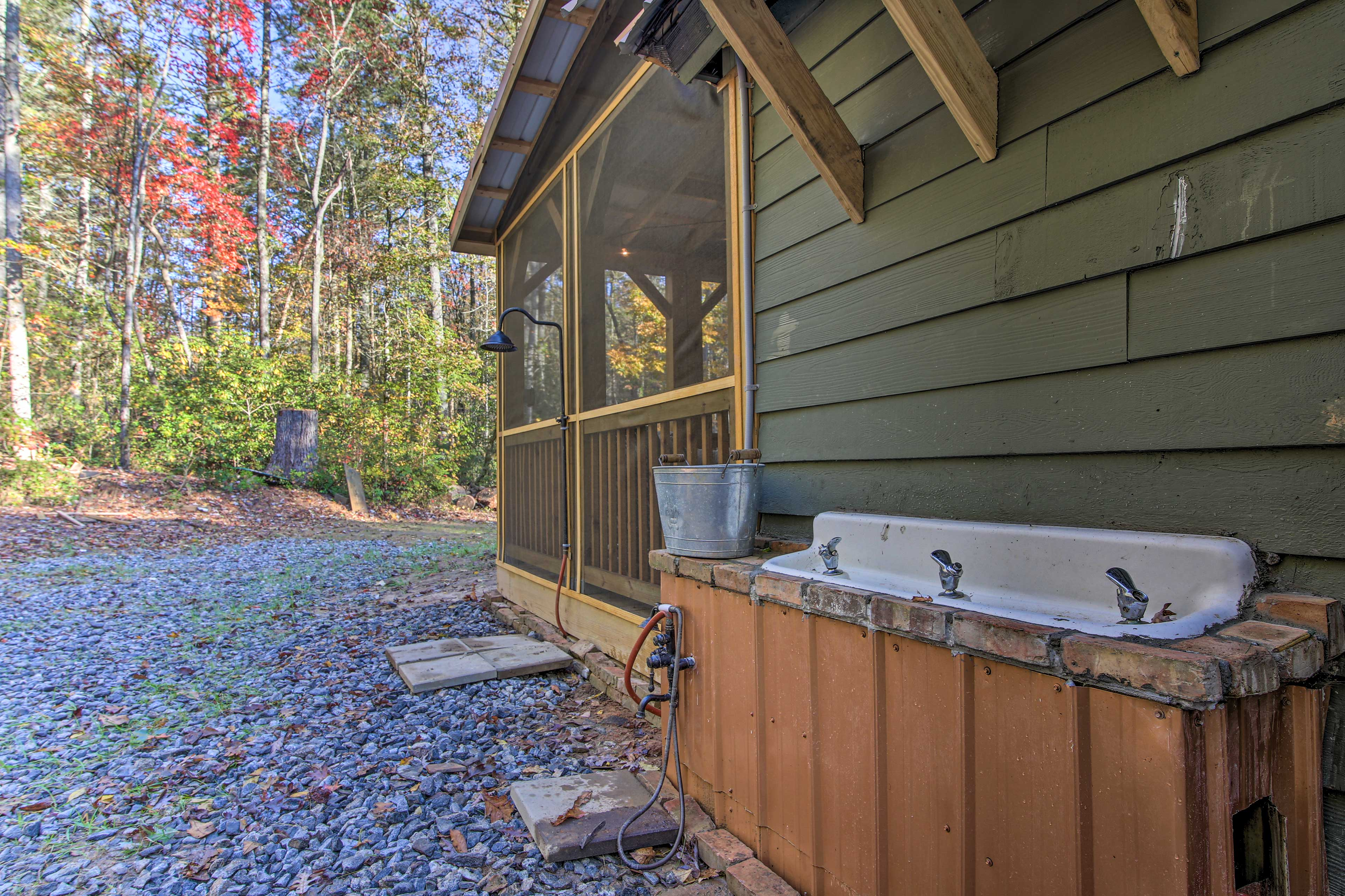 Adding to the home's authenticity, there is an outdoor shower and garden sink.