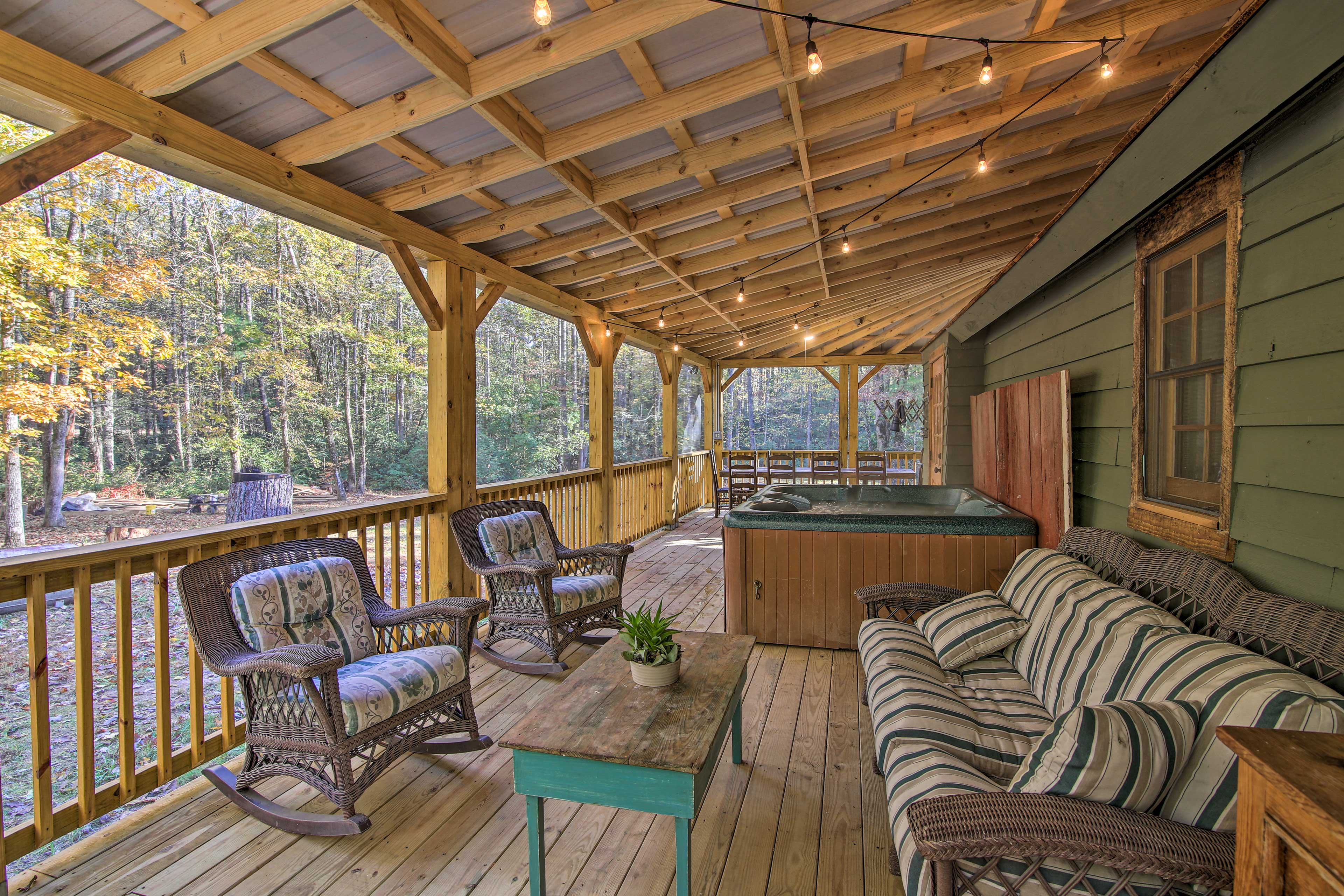 Lounge, relax in the hot tub, or dine on the screened-in porch!