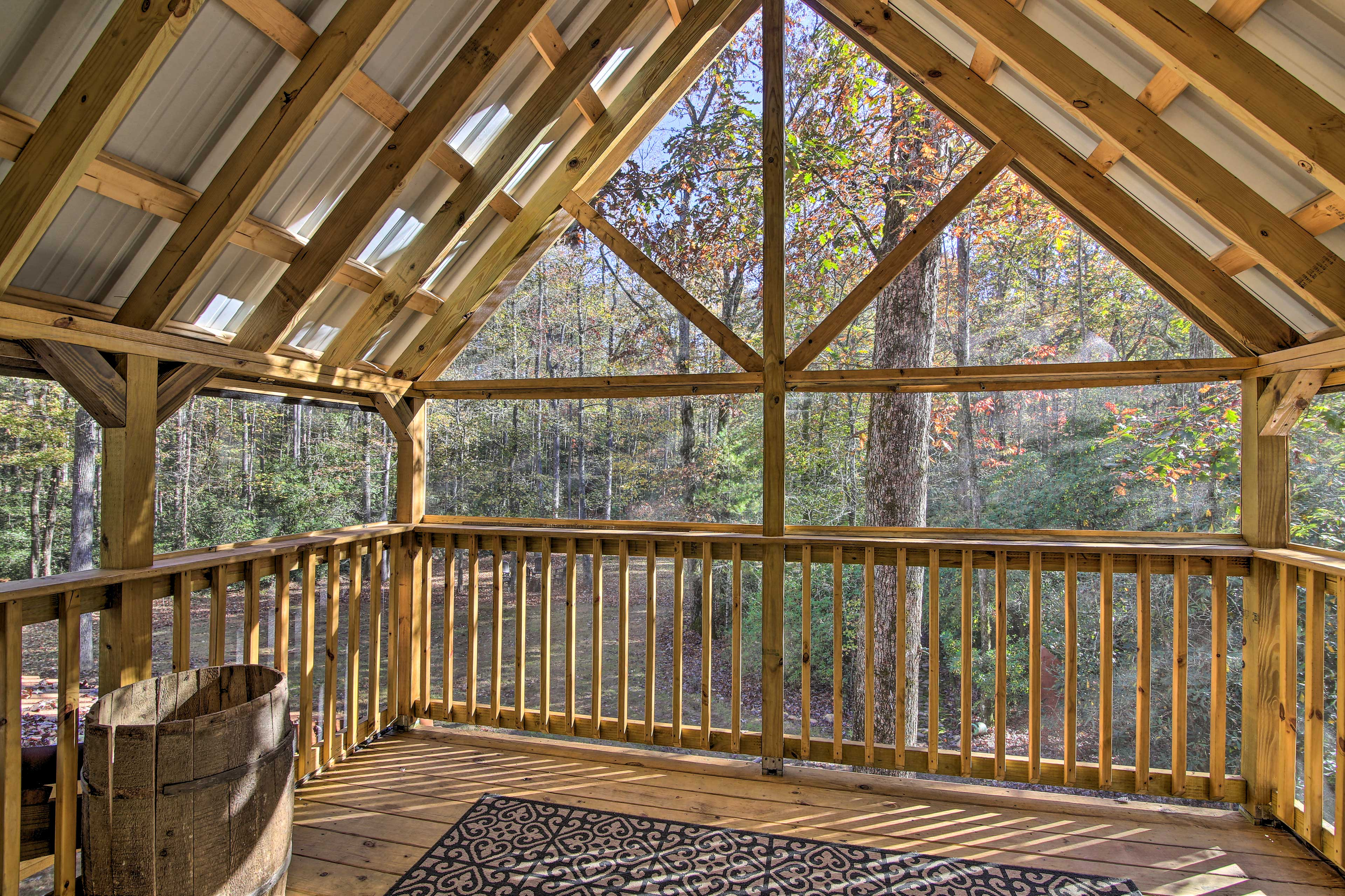 Step out onto the balcony from the third bedroom to enjoy the forest views.