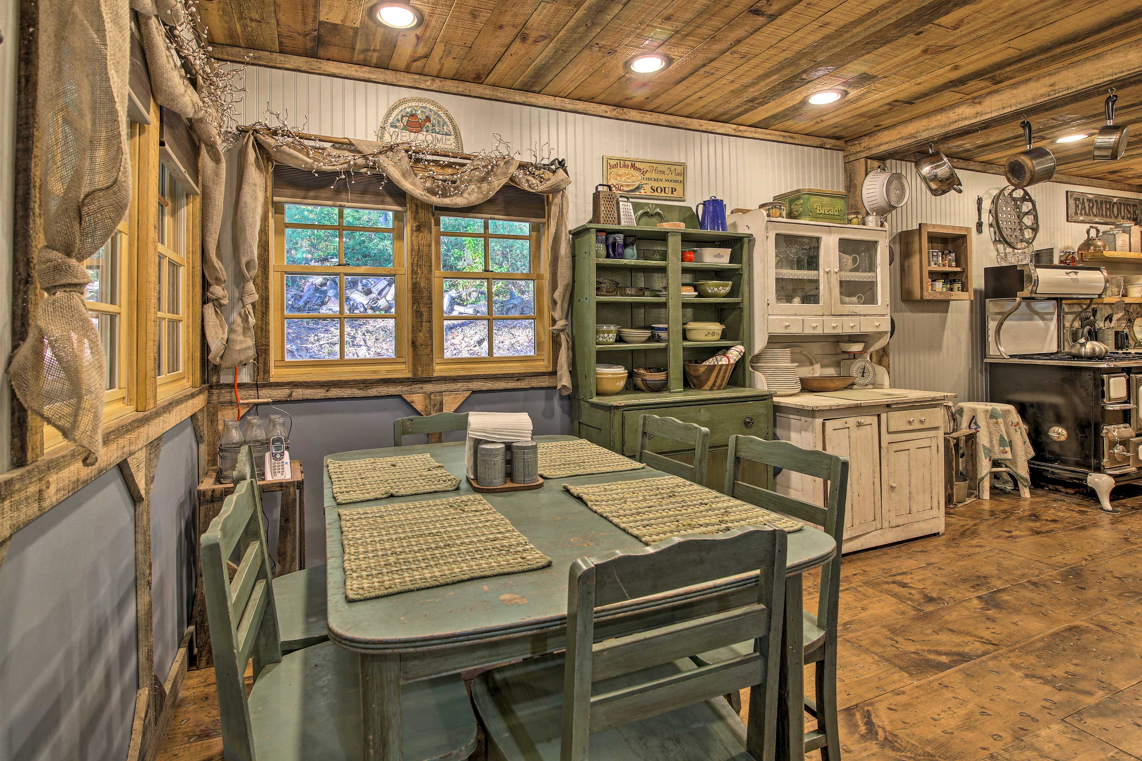 The wood elements and buffet hutches fit right into this rustic kitchen.