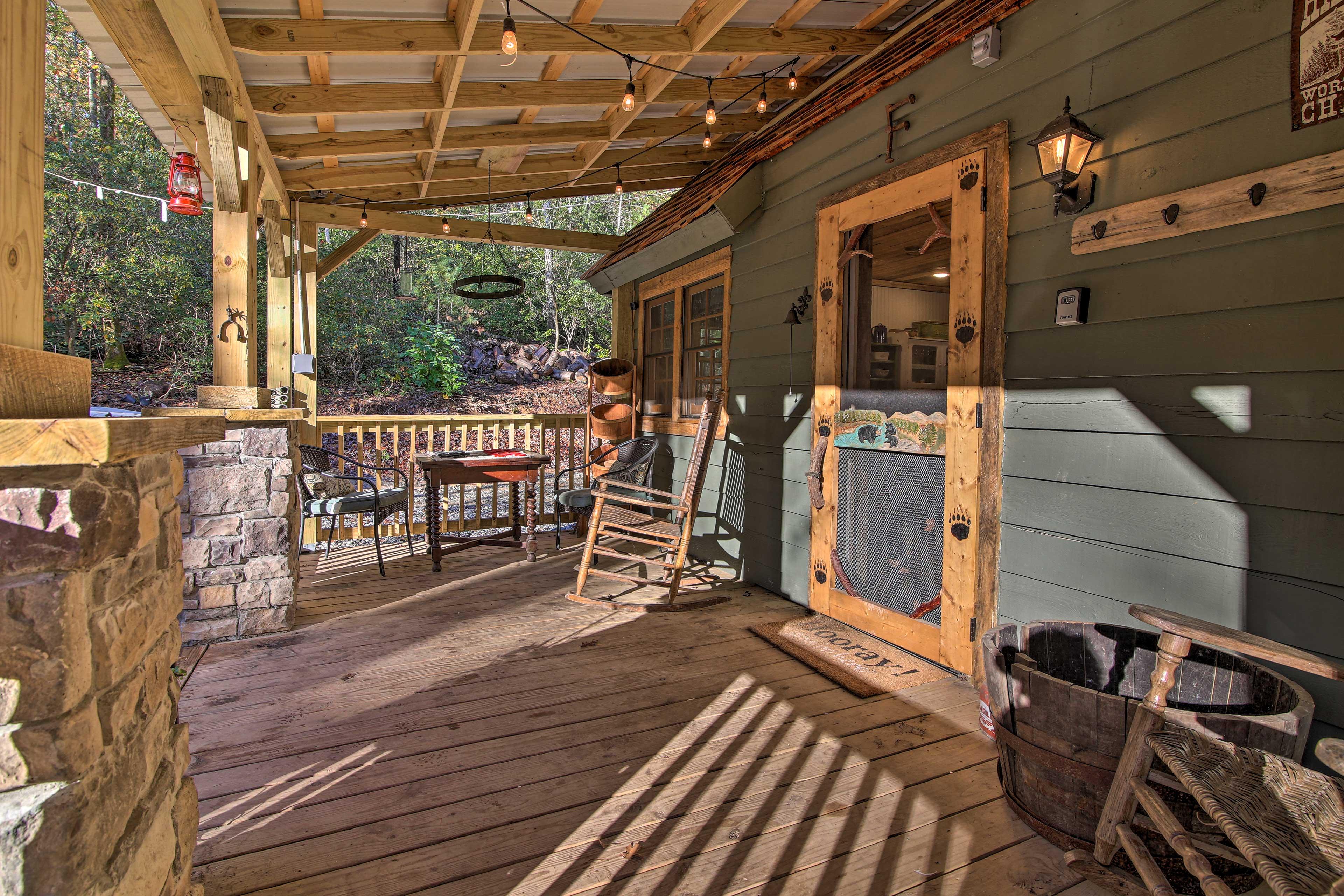 Edison-style string lights illuminate the spacious wraparound porch.