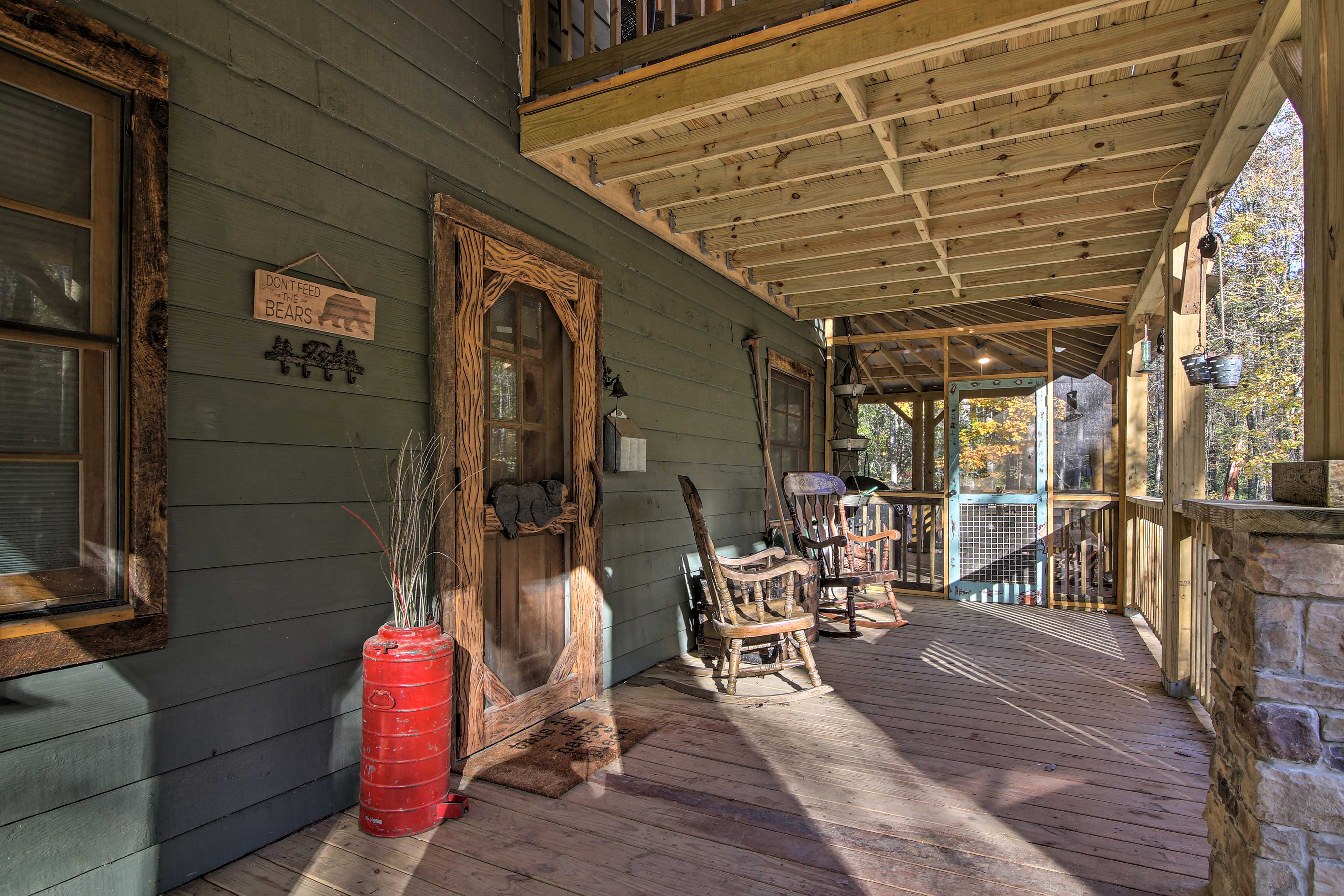 There is plenty of seating on porch, including rocking chairs.
