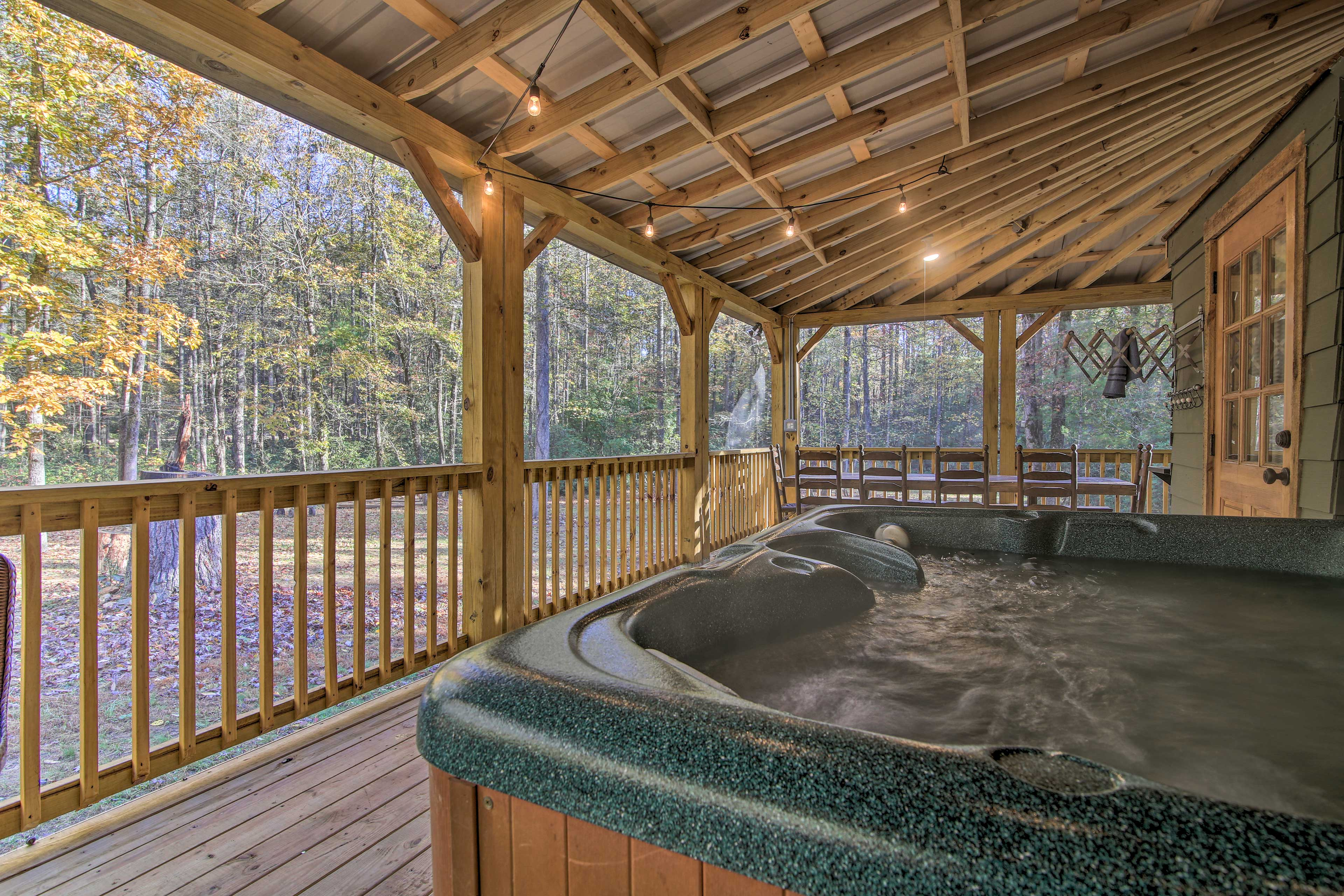 Take a relaxing soak in the hot tub on the screened-in porch!