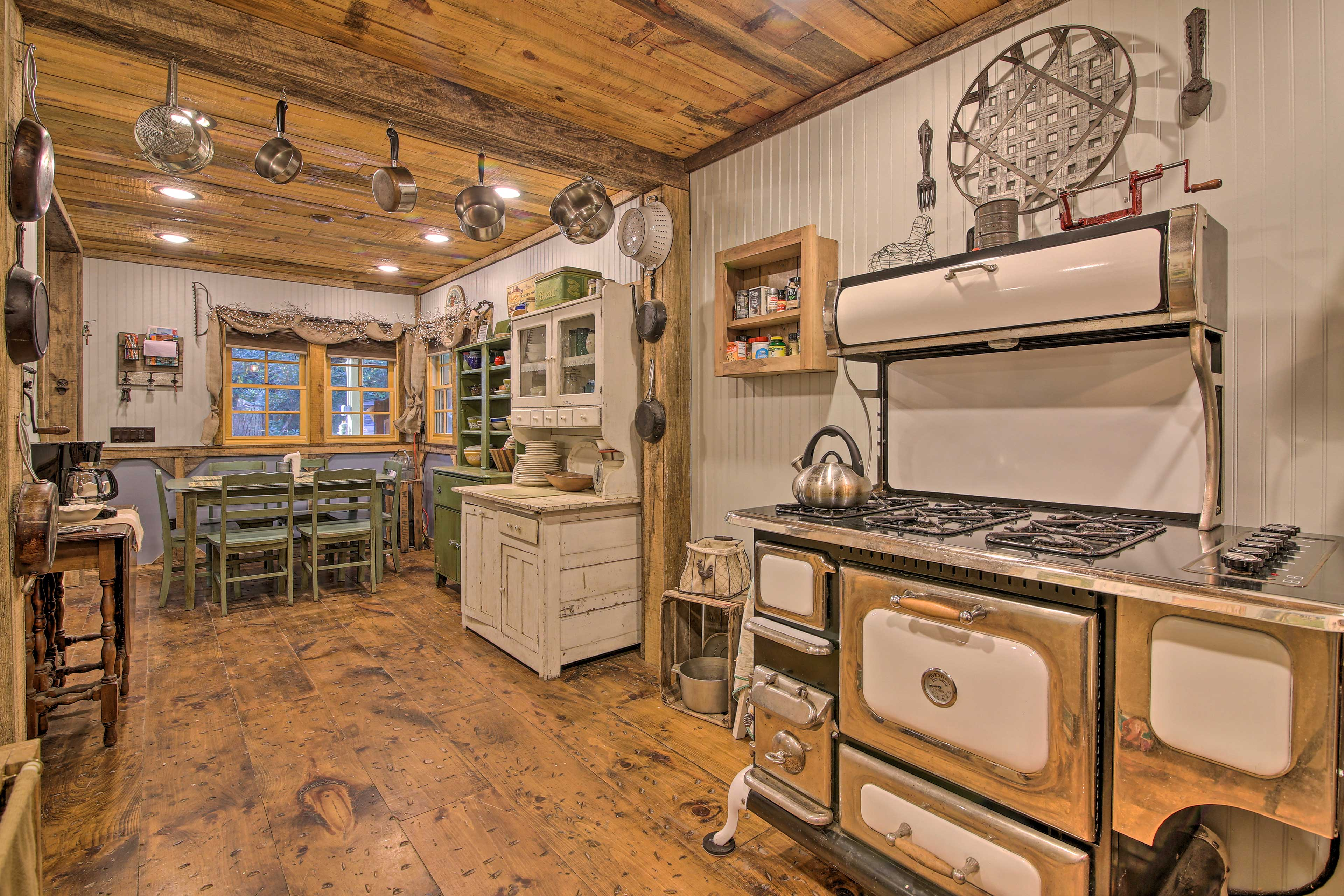 The kitchen features a statement-making retro gas stove.