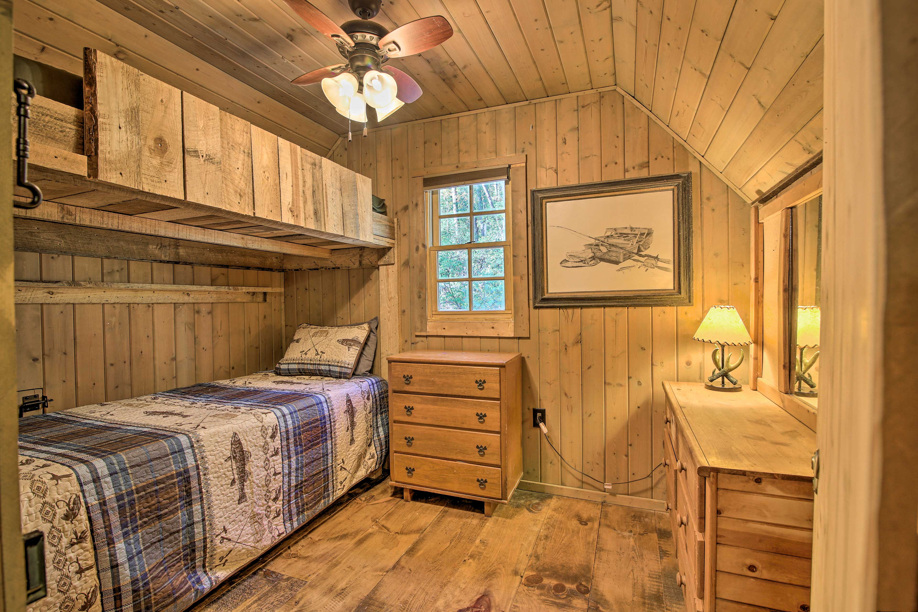 The second bedroom has twin bunk beds and 2 dressers.