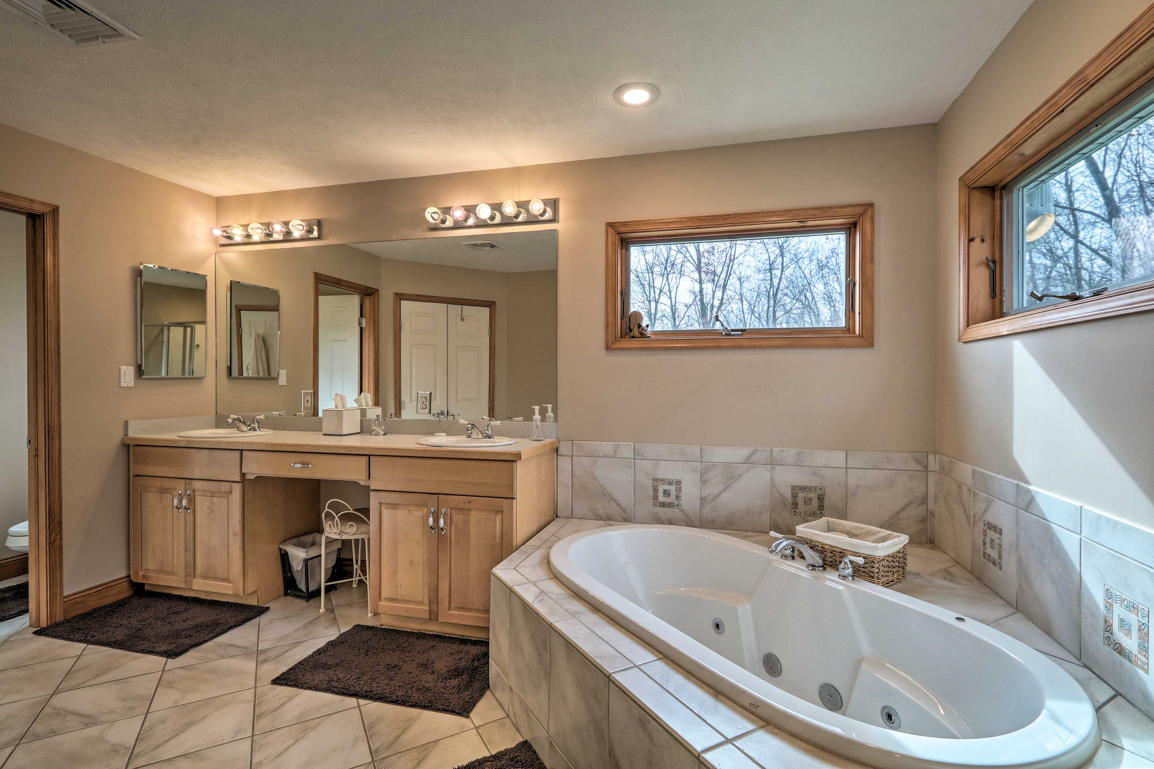 The master bathroom features a jetted tub.