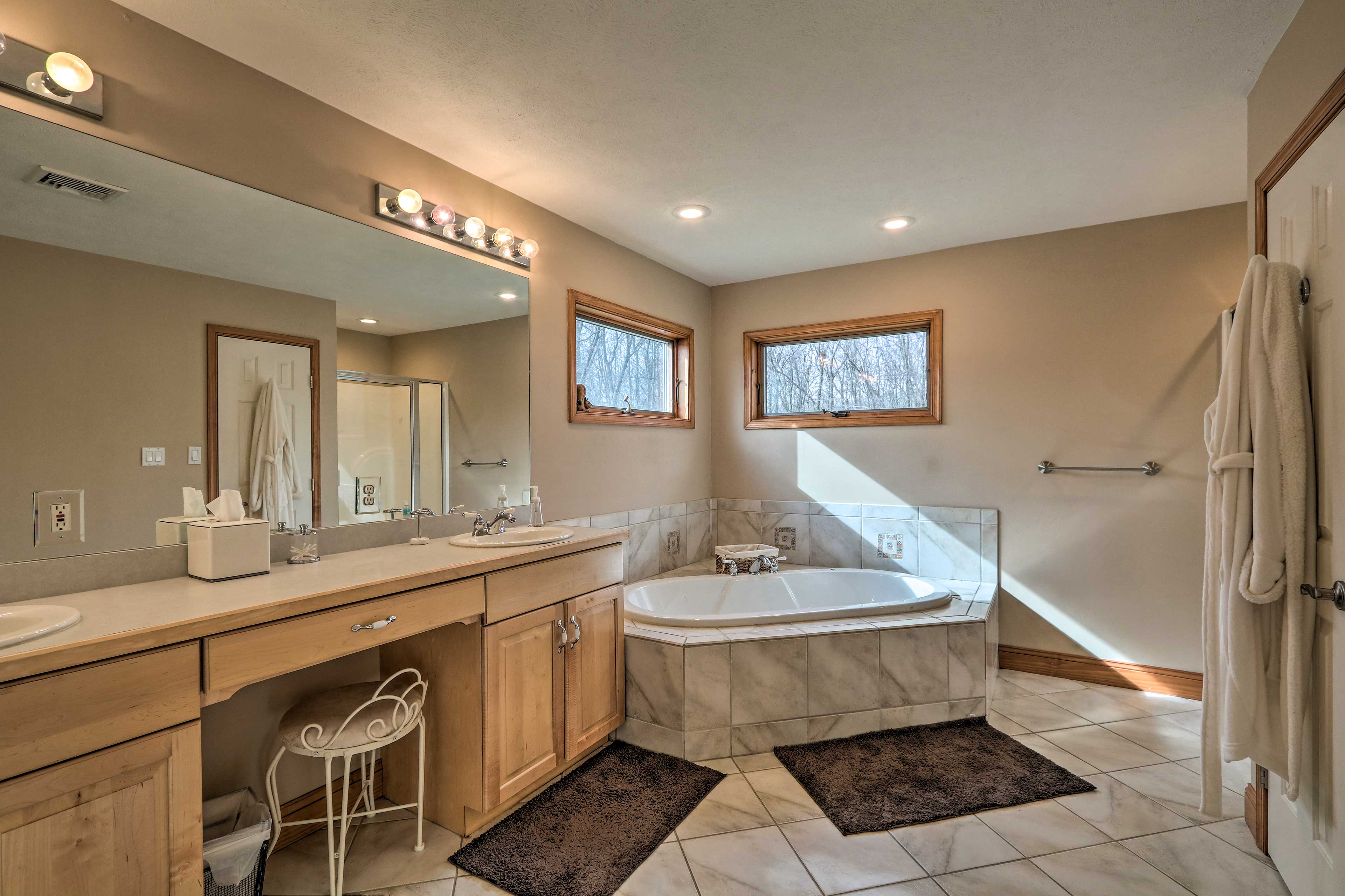 Get ready in the spacious bathroom.