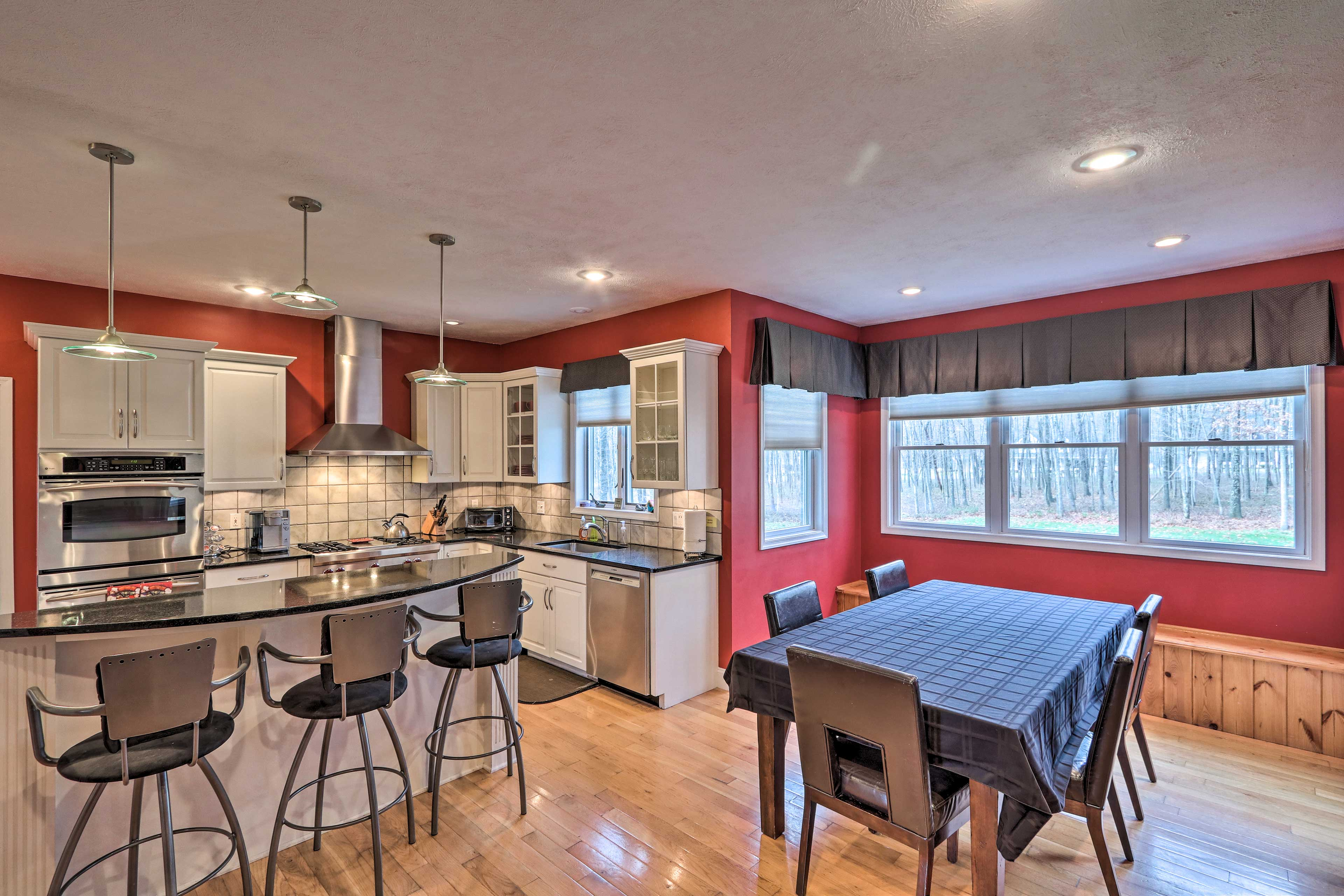 Natural light illuminates this kitchen and dining area.