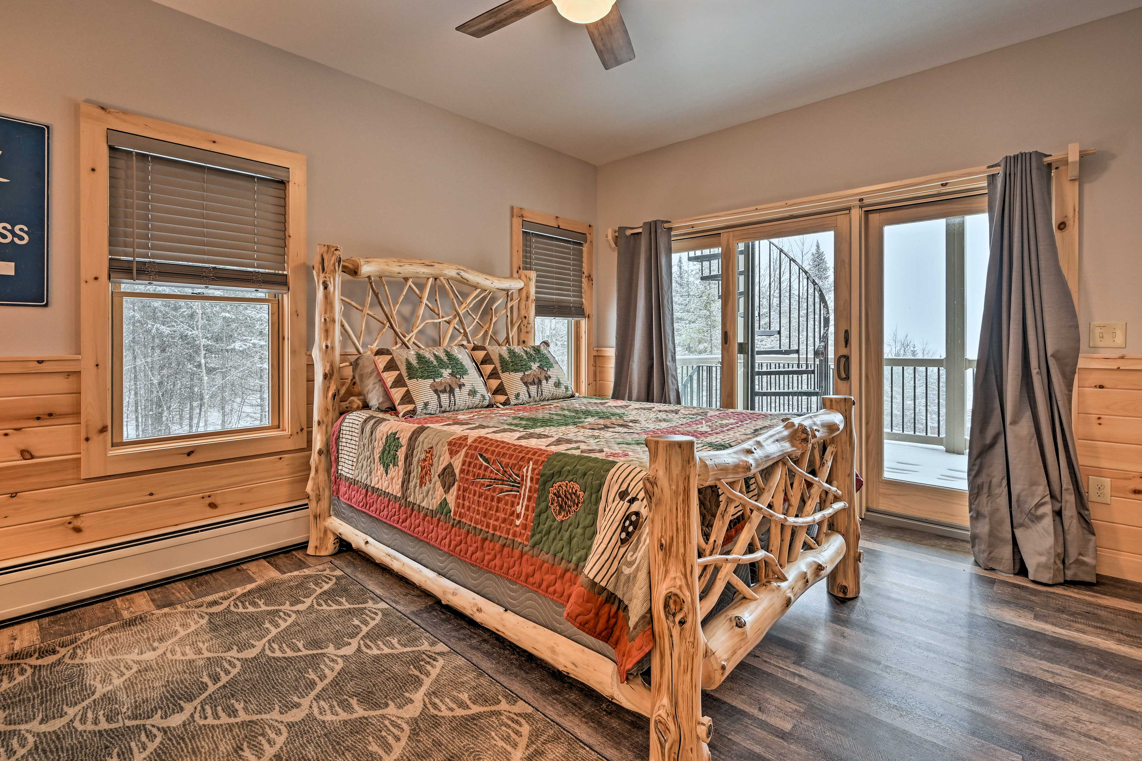The master bedroom features a queen bed and balcony access.