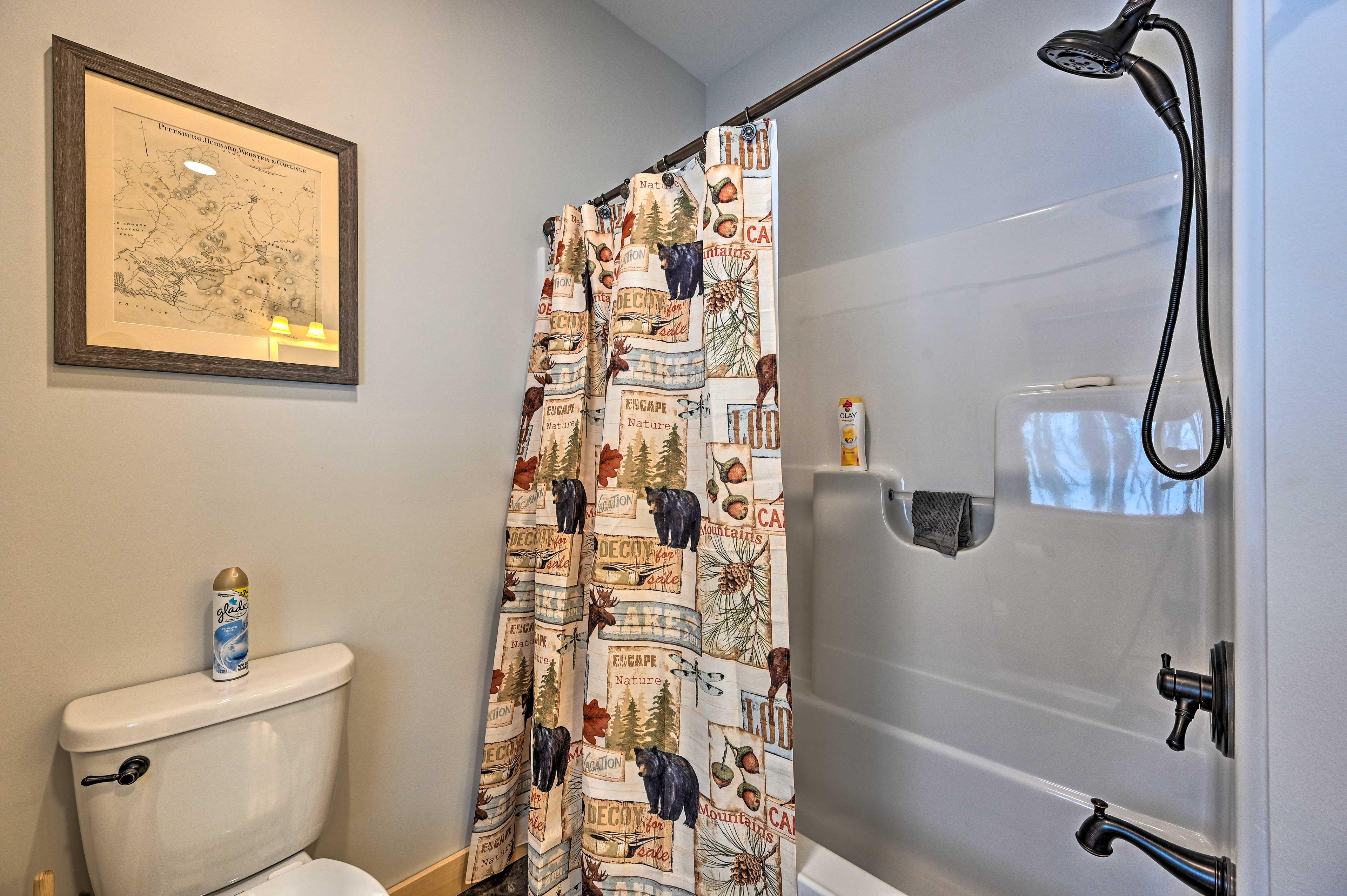 Take a shower or a bath in this full bathroom.