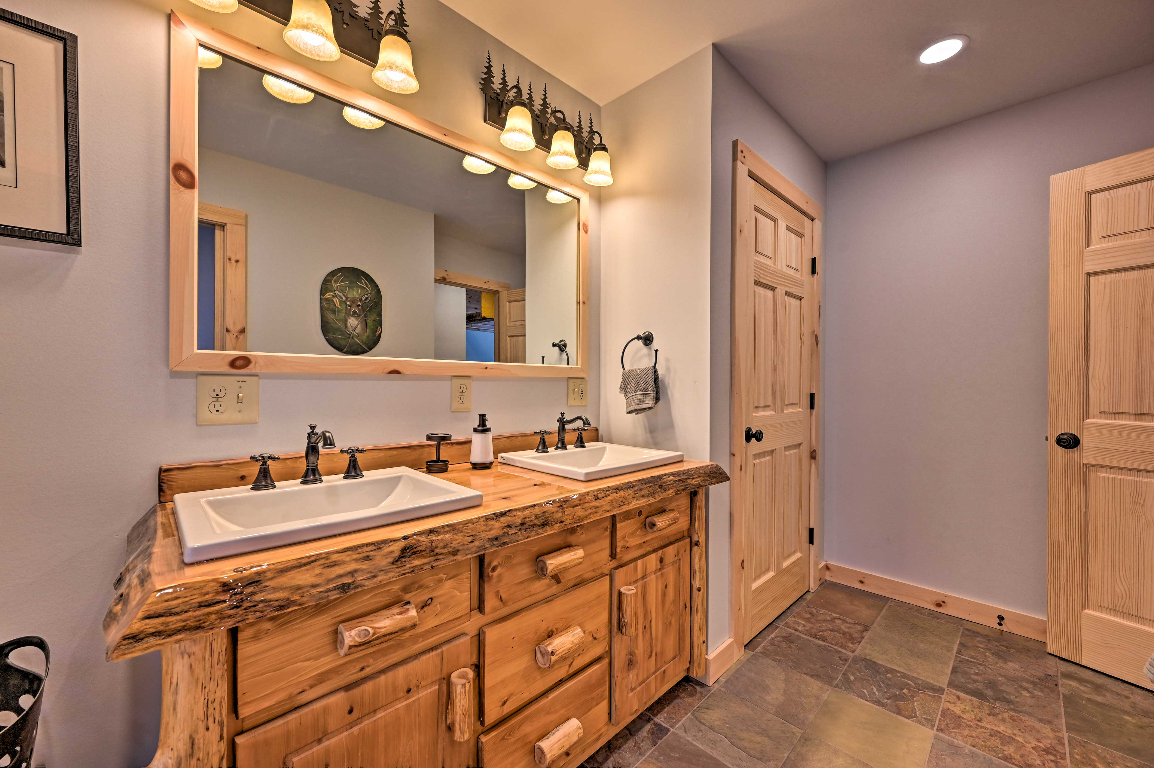 Get ready with your companion in the master bathroom with dual sinks.