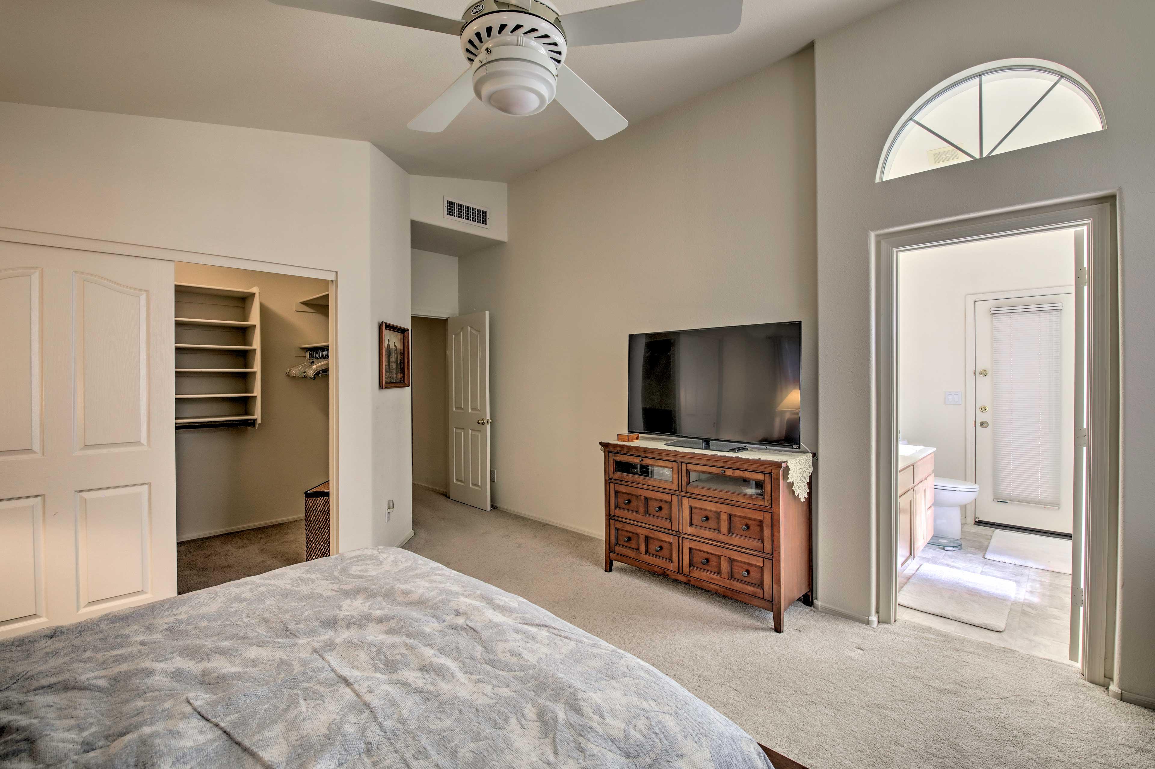 The master bedroom comfortably sleeps 2 in the queen bed.