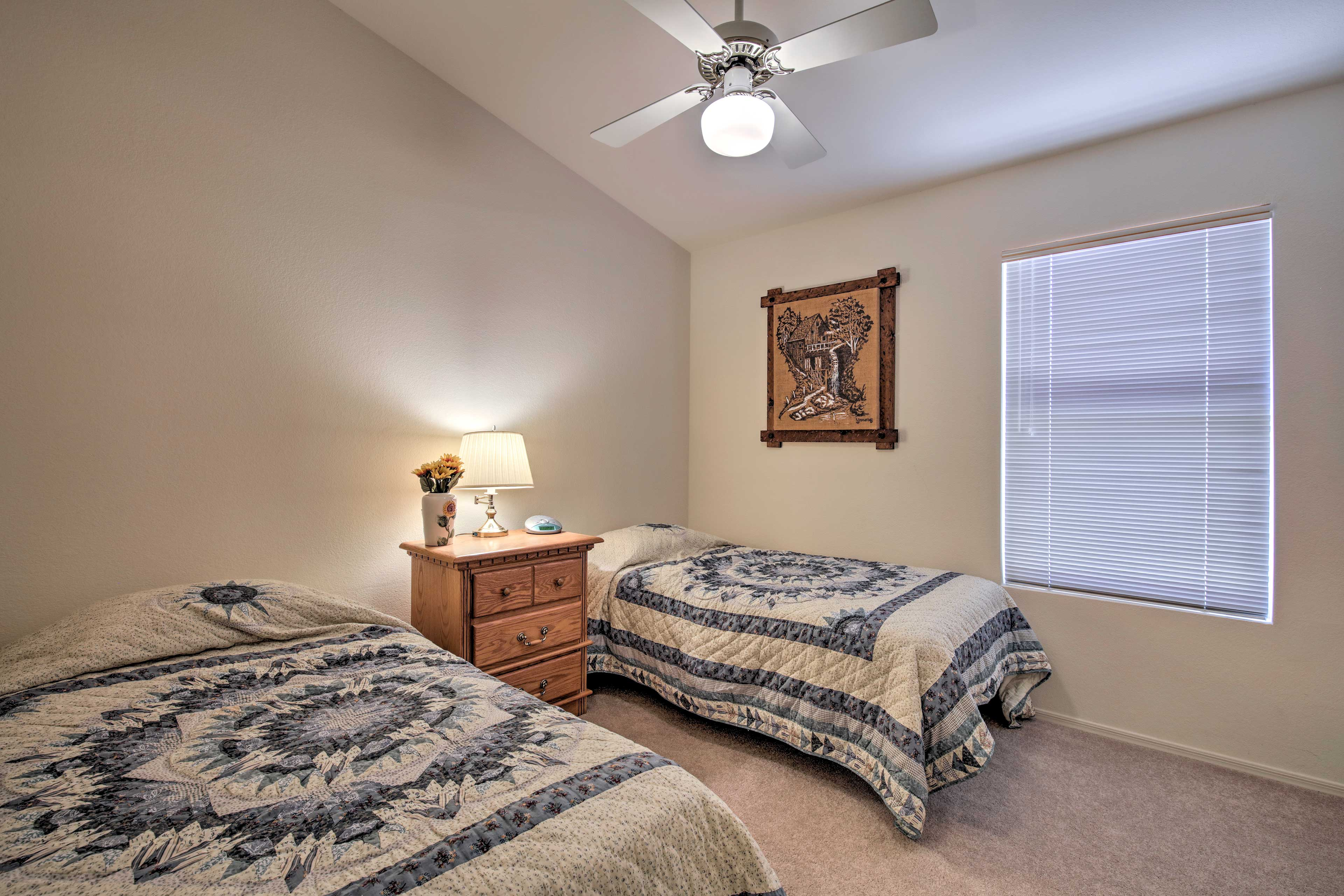Unpack, unwind, and get rest in this bedroom with 2 twin beds.