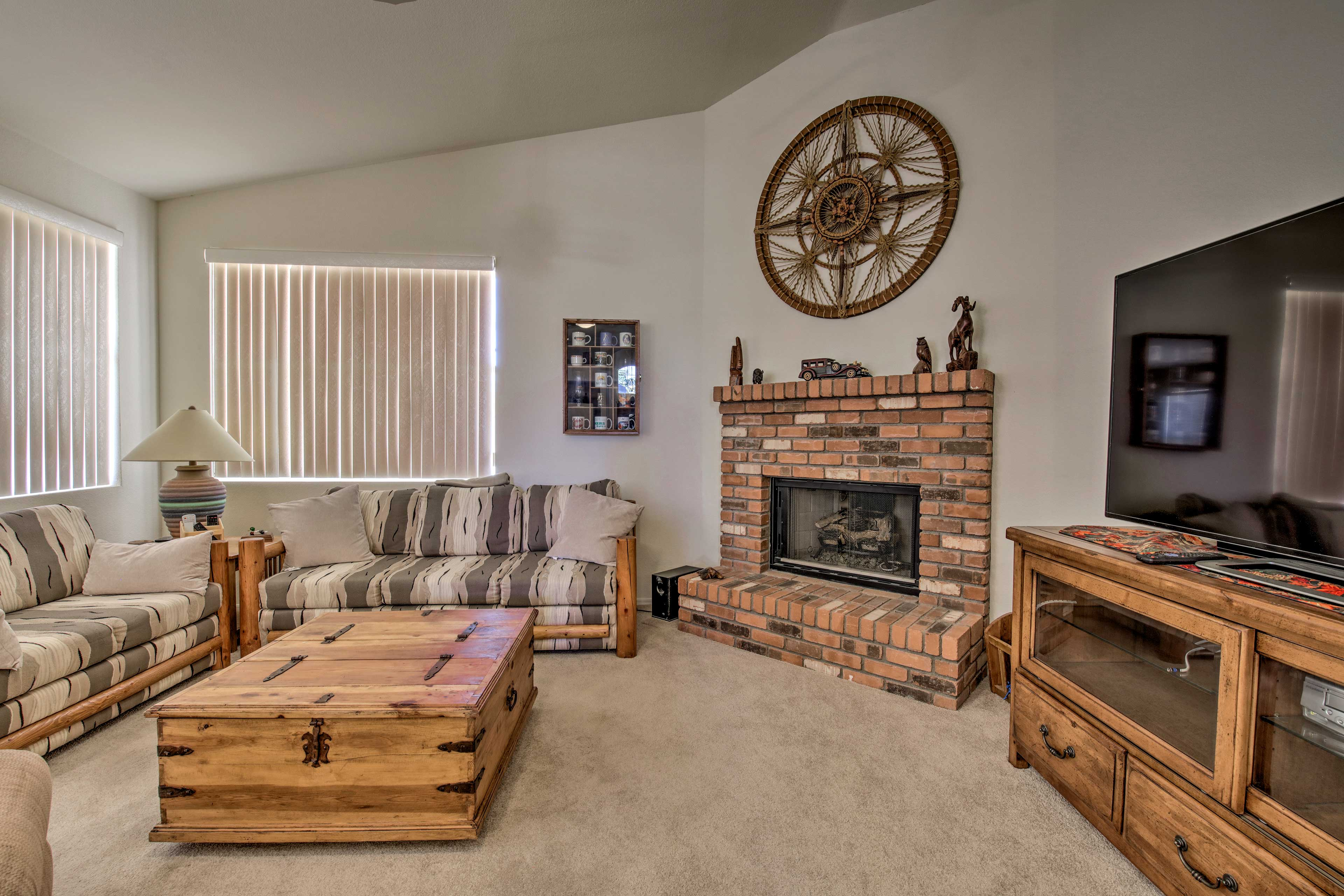 Get cozy around the fireplace as you watch TV.