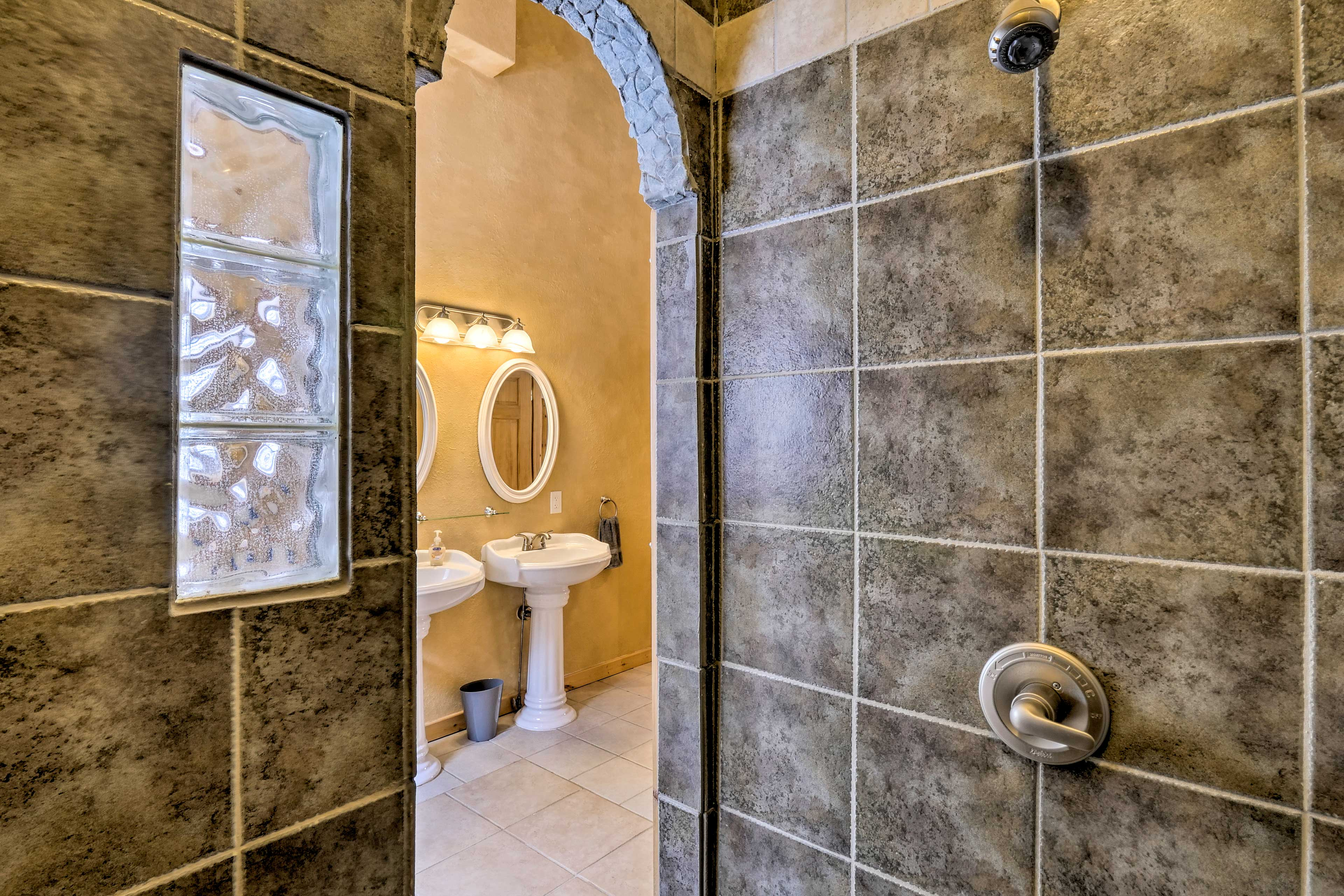 This unique tile shower will be a welcome start to your day.