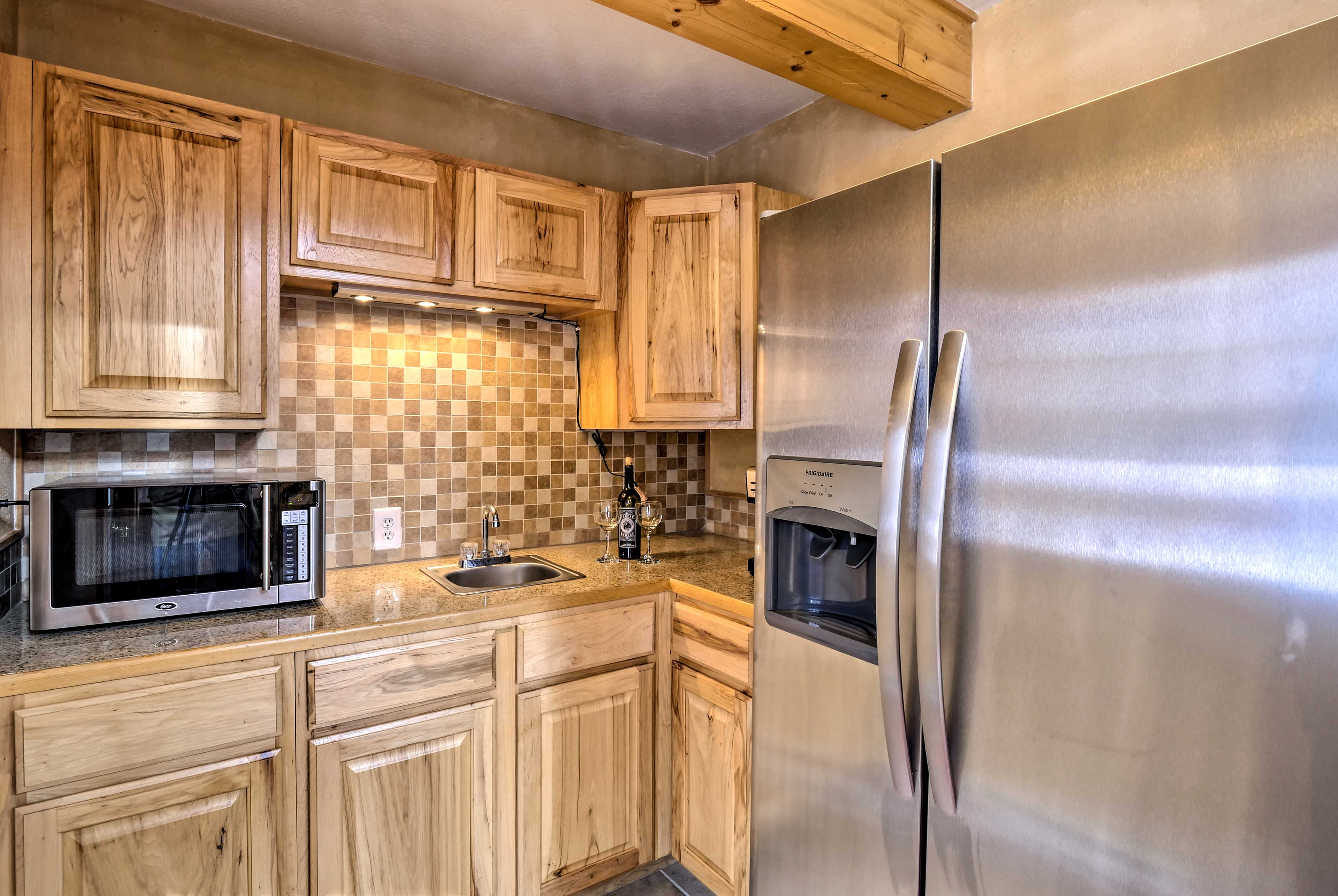 The full kitchen includes stainless steel appliances.