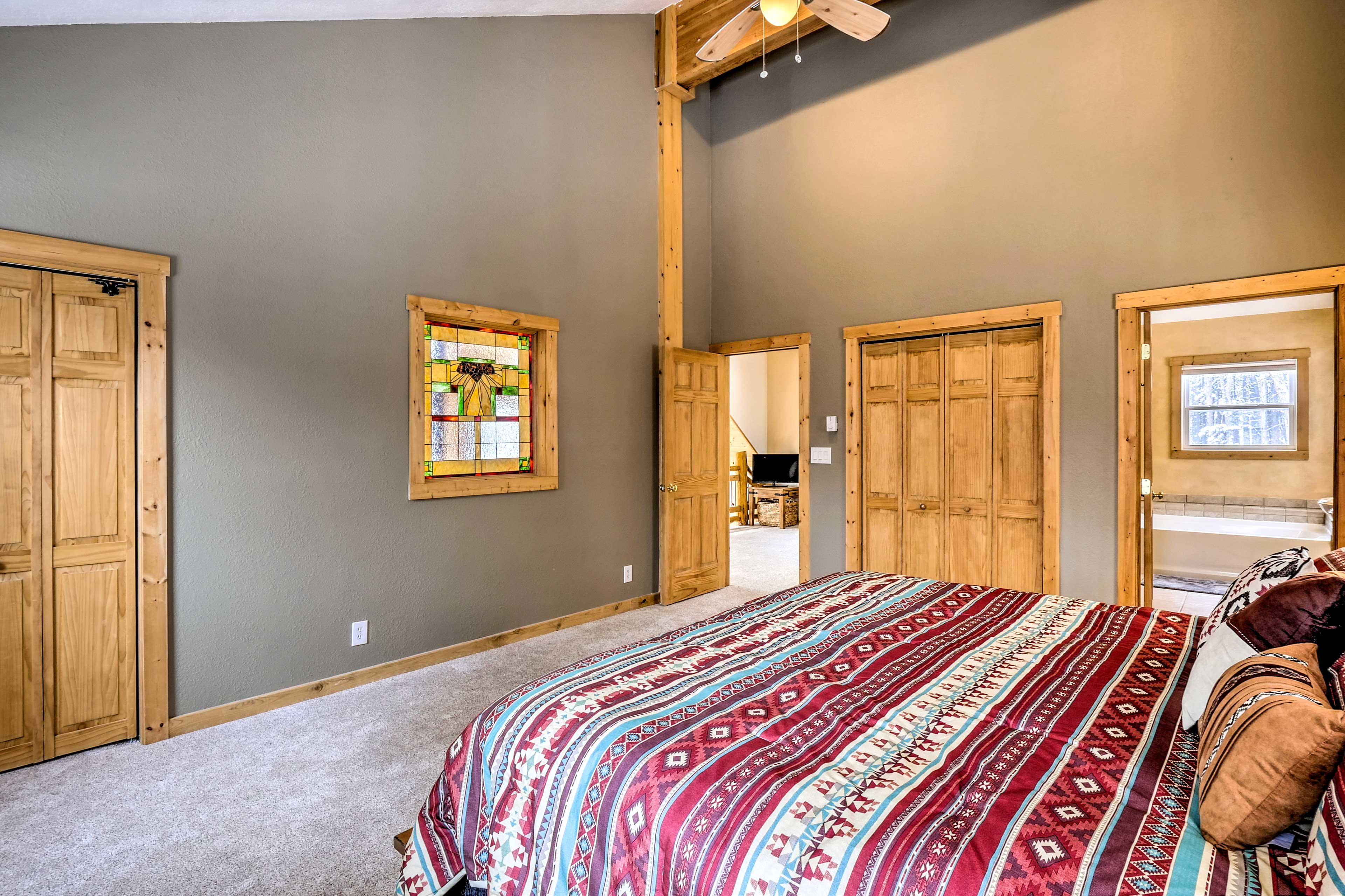 You'll find the master suite just off the loft landing area.