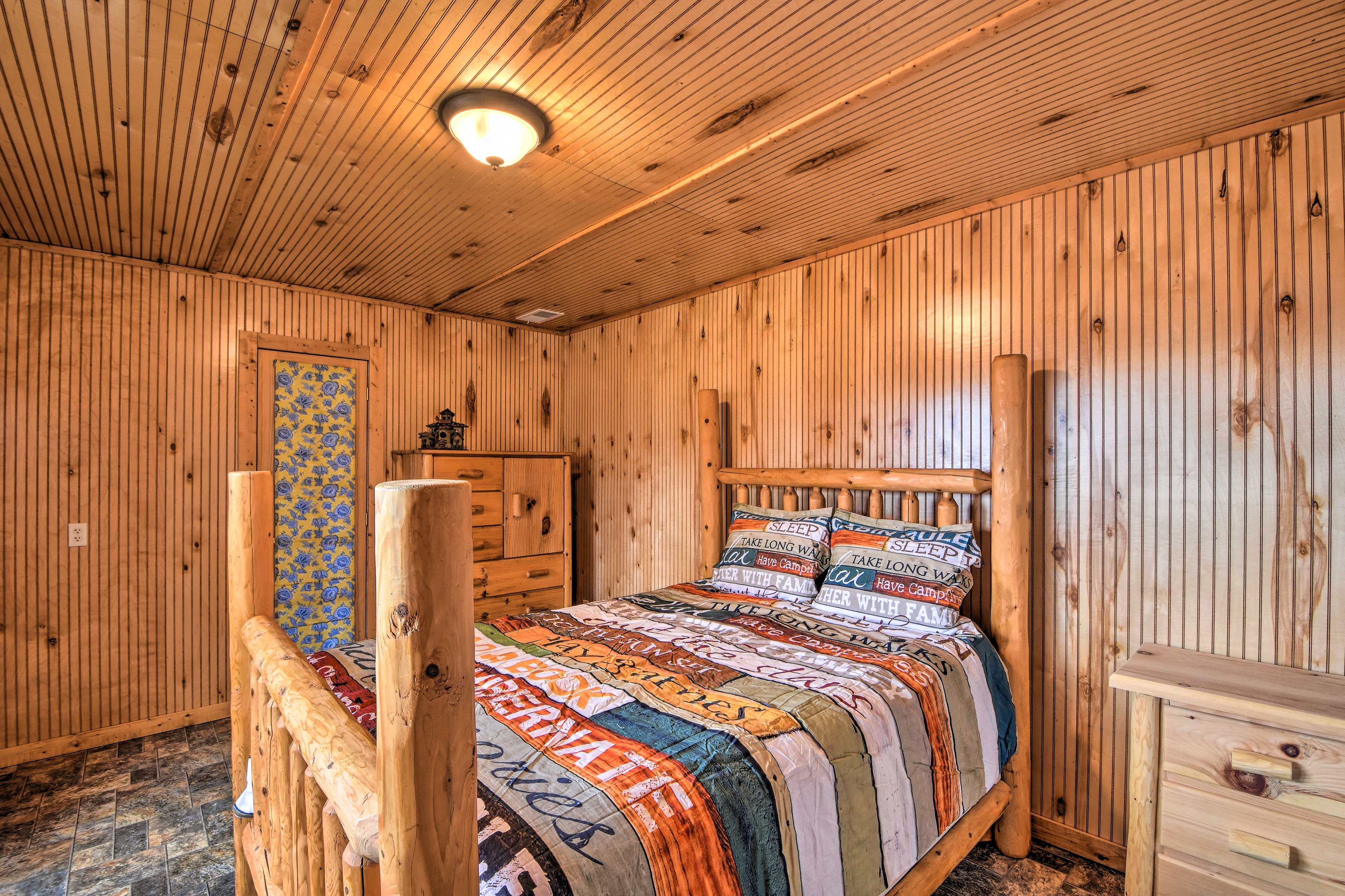 Claim this log-furnished queen bed as your own.