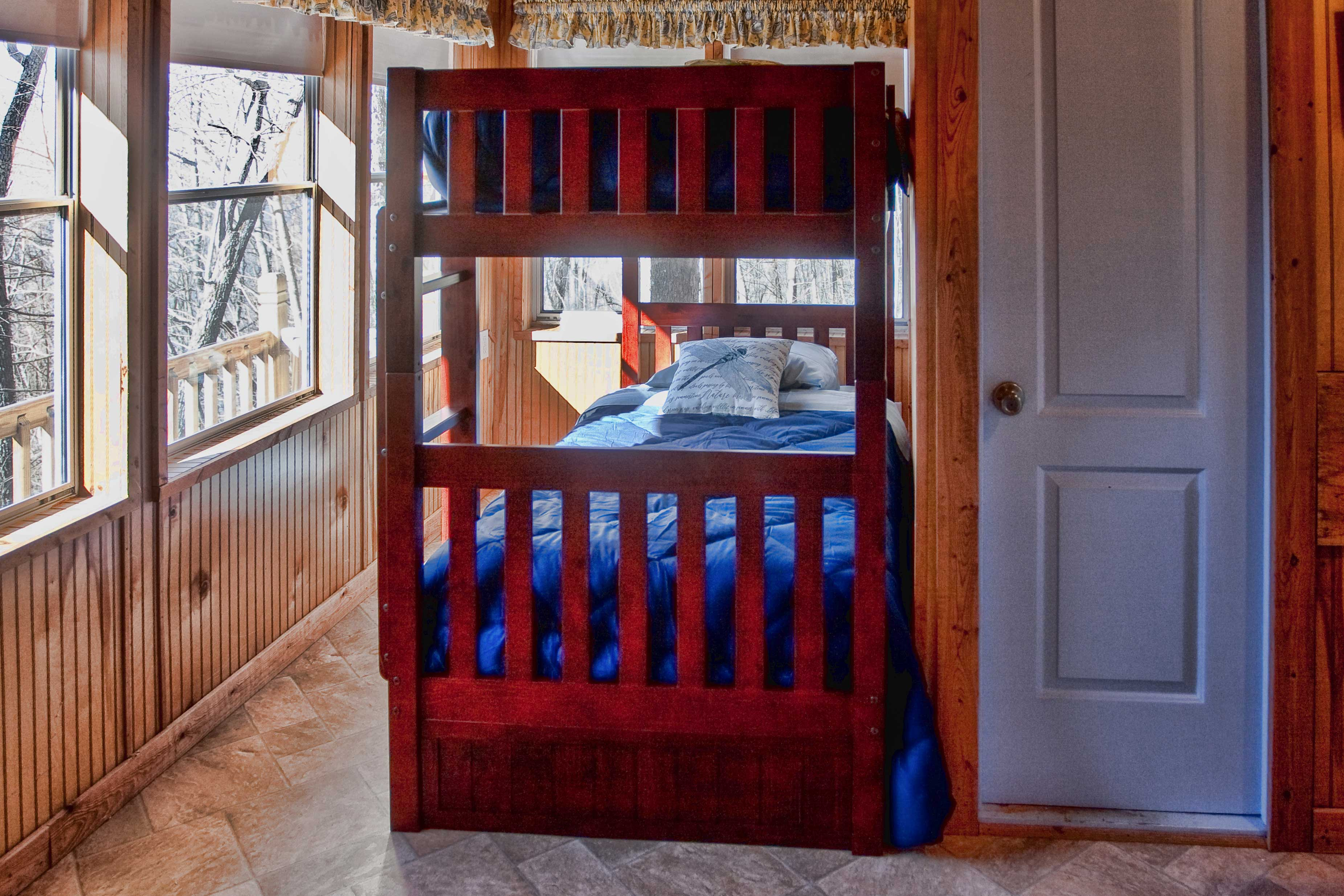 The second bedroom features a twin bunk bed.