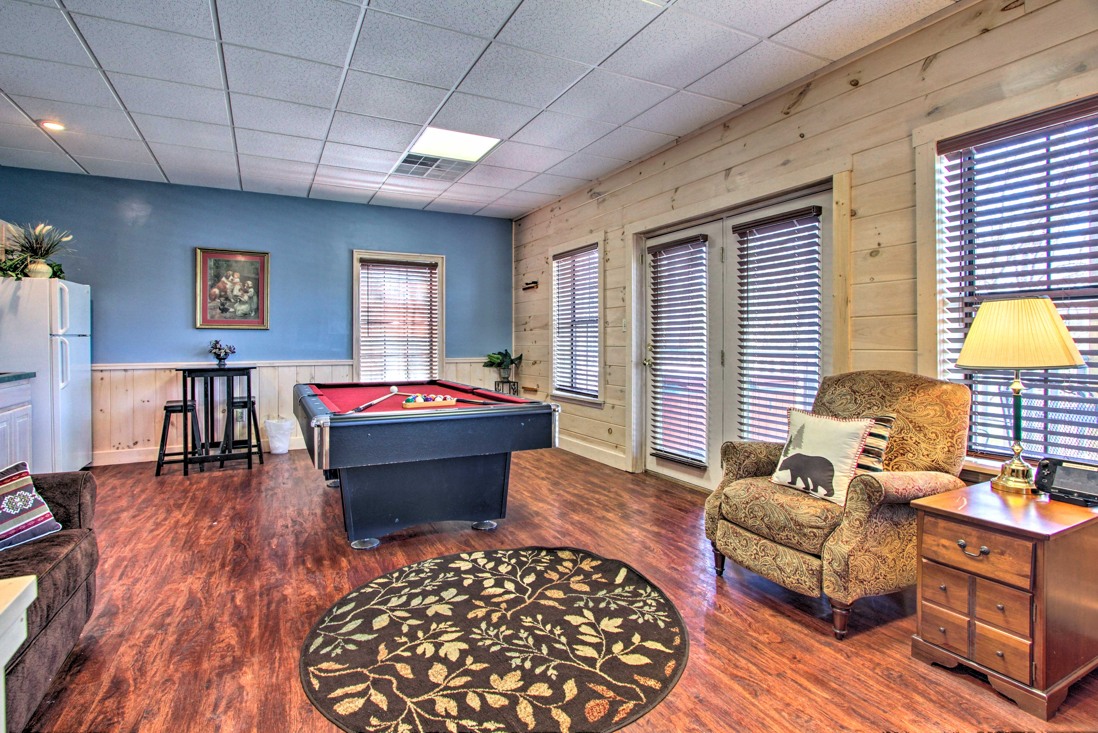 Downstairs, a game room with a pool table awaits!