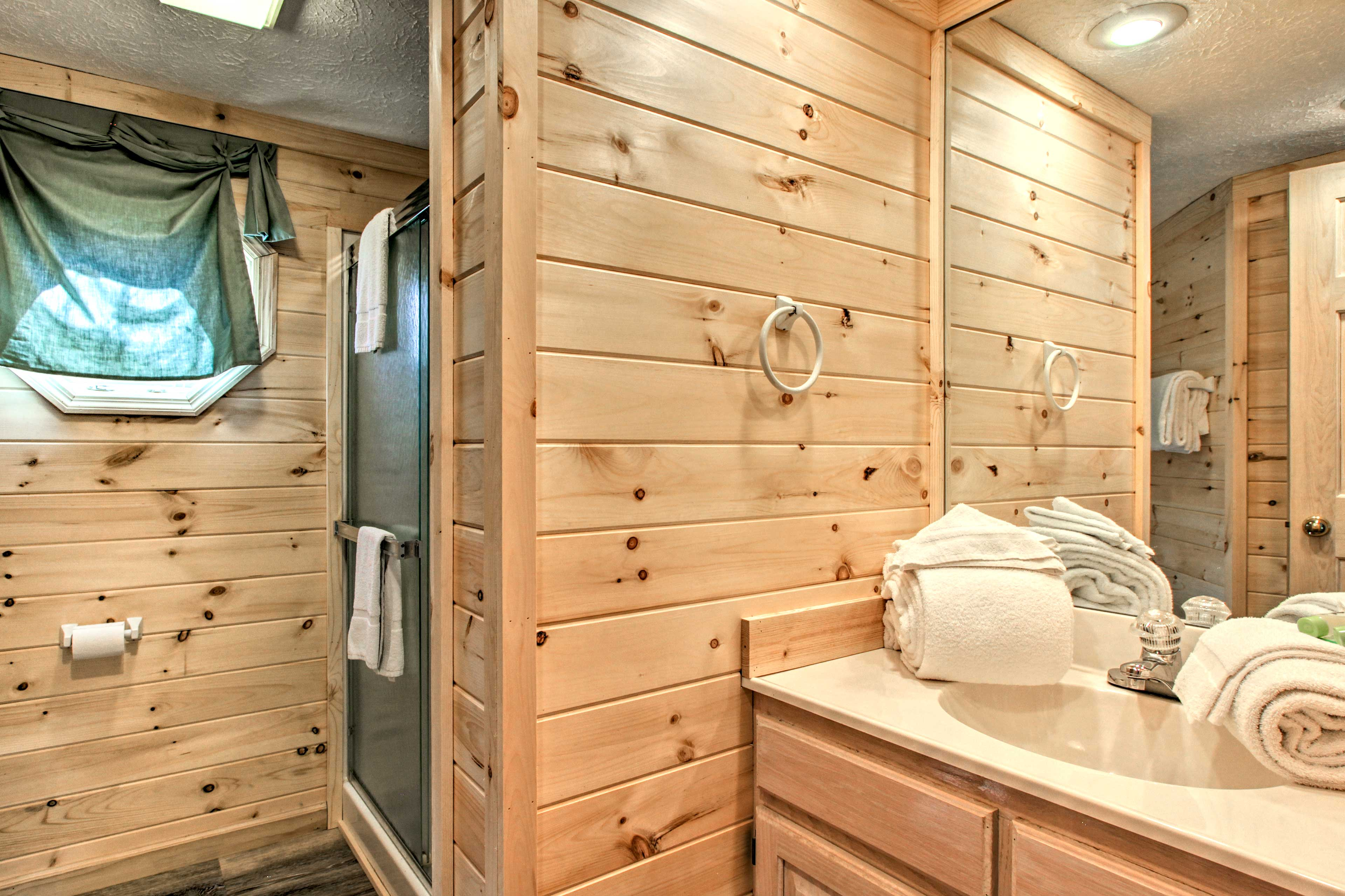 The spacious master bath offers a walk-in shower.