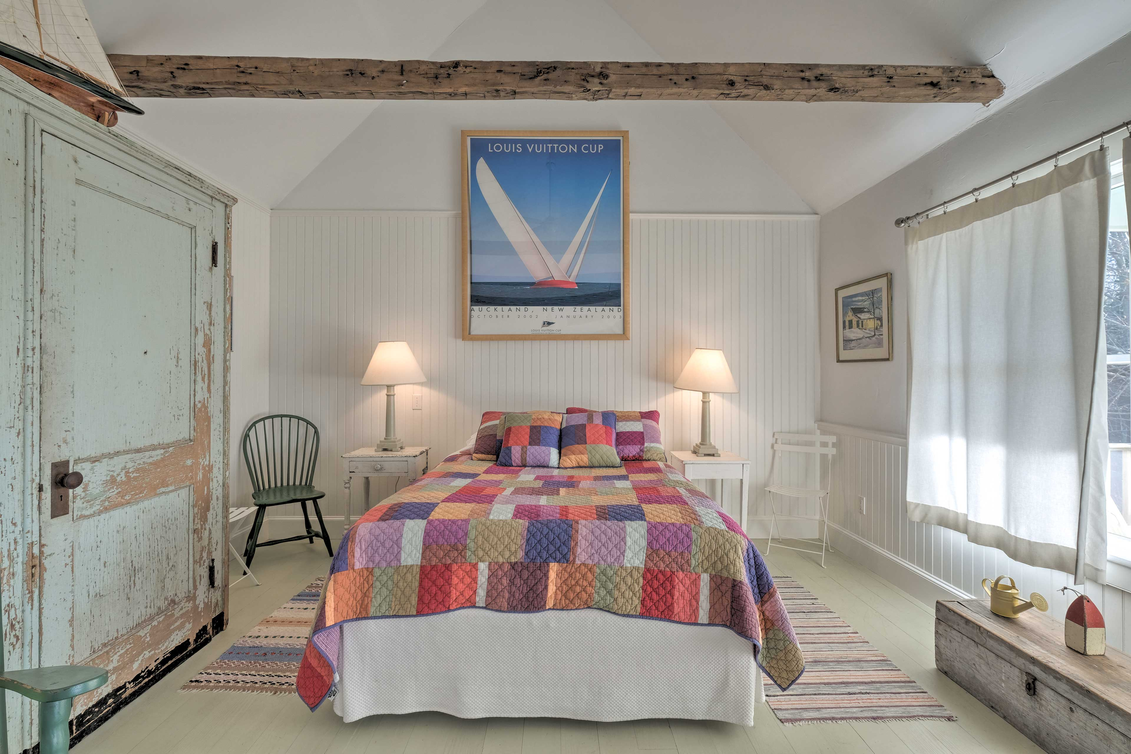 Many restful nights await on this queen bed.
